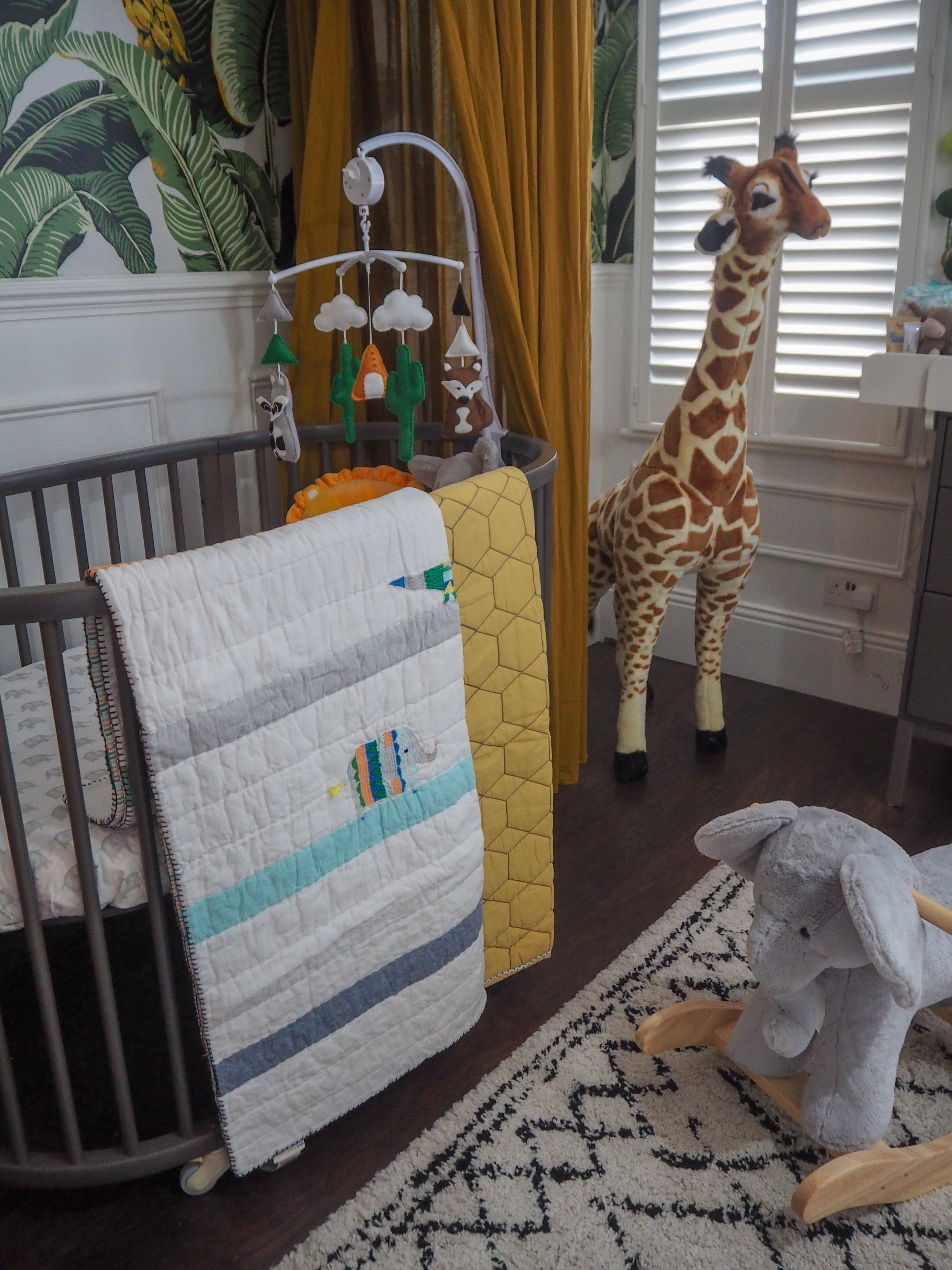 Colby Animal Baby    quilt  £149 from Pottery barn kids;   Honeycomb Baby Bed Linen     £79 from Pottery barn kids;   Melissa & Doug Plush Giraffe   £84.99 from Argos. Mobile made by my mum.