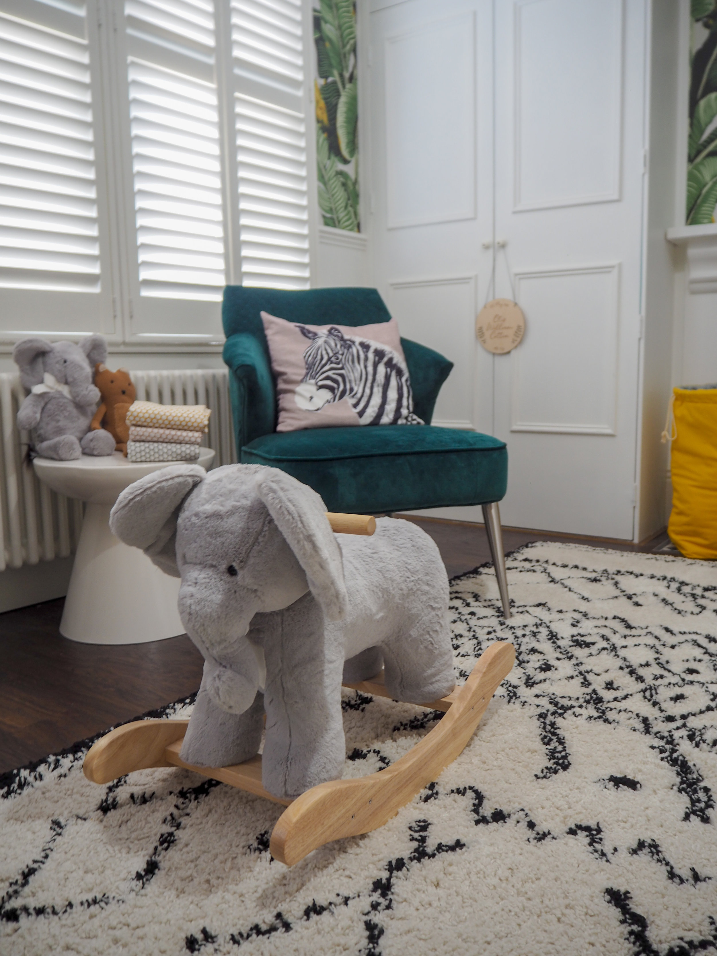 Elephant plush rocker   £149 from Pottery barn kids;   Afaw Berber Style Rug   from £269 La Redoute;   Collins side table   £149 from Pottery barn kids;   west elm x pbk Bear Plush   £29 from Pottery barn kids;   Medium plush elephant   £29 from Pottery barn kids;   west elm x pbk Dot Muslin Swaddle Set: Platinum, Rosette & Horseradish     £49 from Pottery barn .