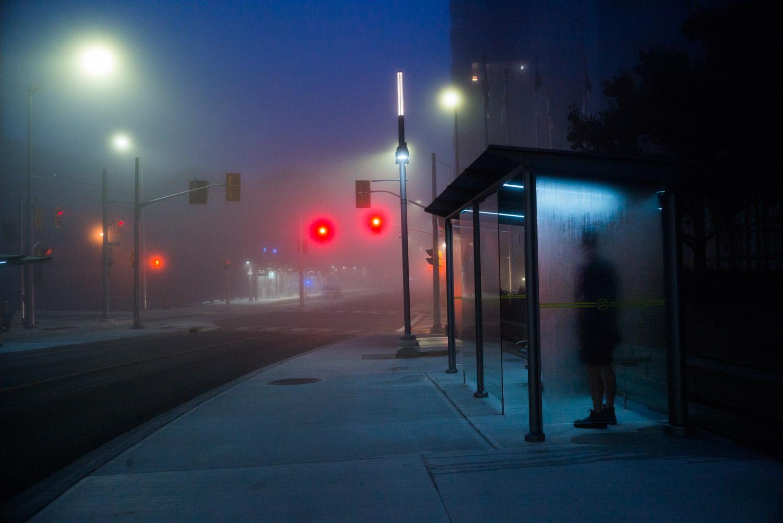 man standing in a bus stop.jpg