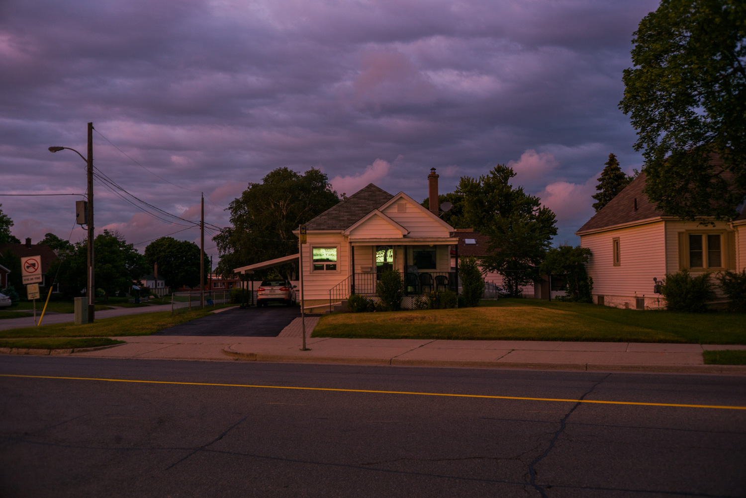house with green light in window.jpg