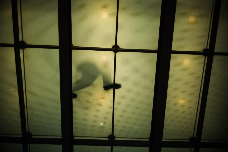 mans feet through glass.jpg