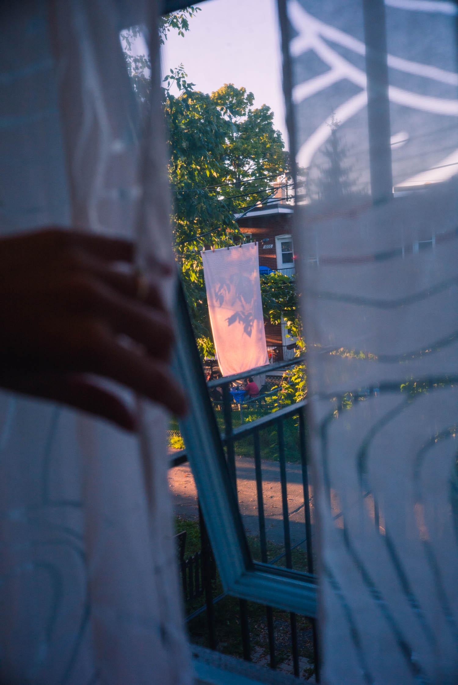 hand holding a curtain open.jpg