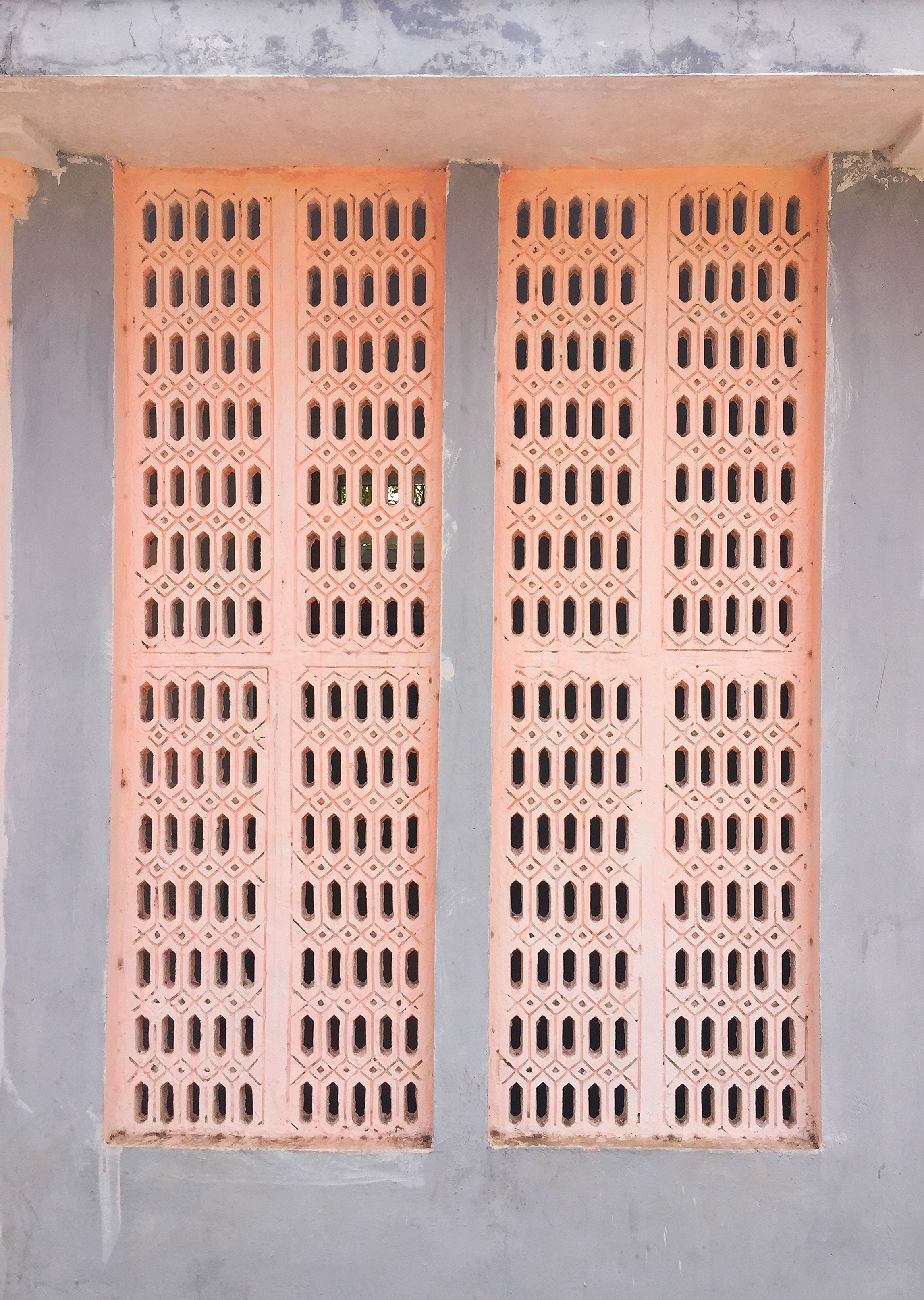 Lattice concrete window at a public bathroom
