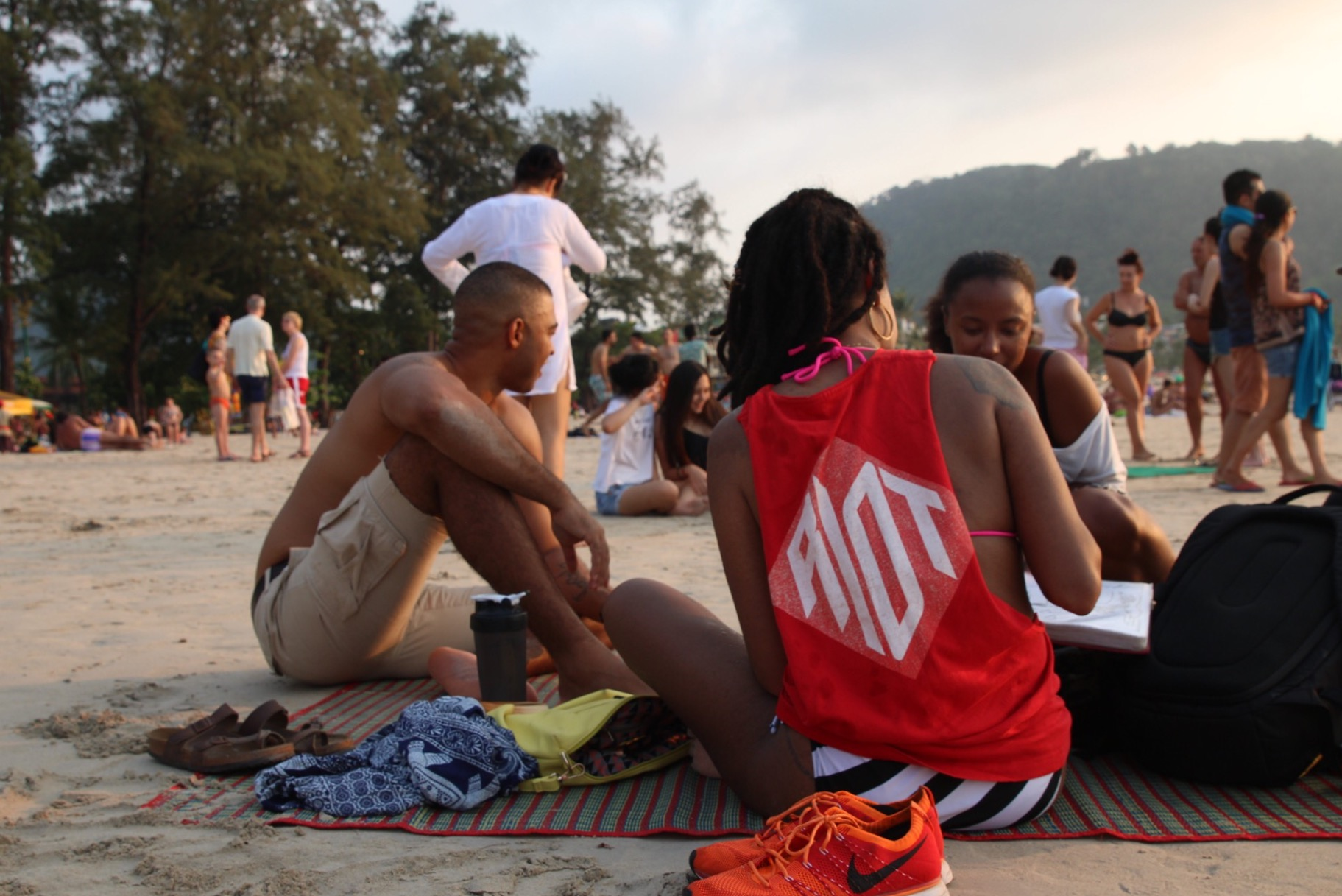 Chilling with another traveling couple on Patong Beach in Phuket, Thailand.