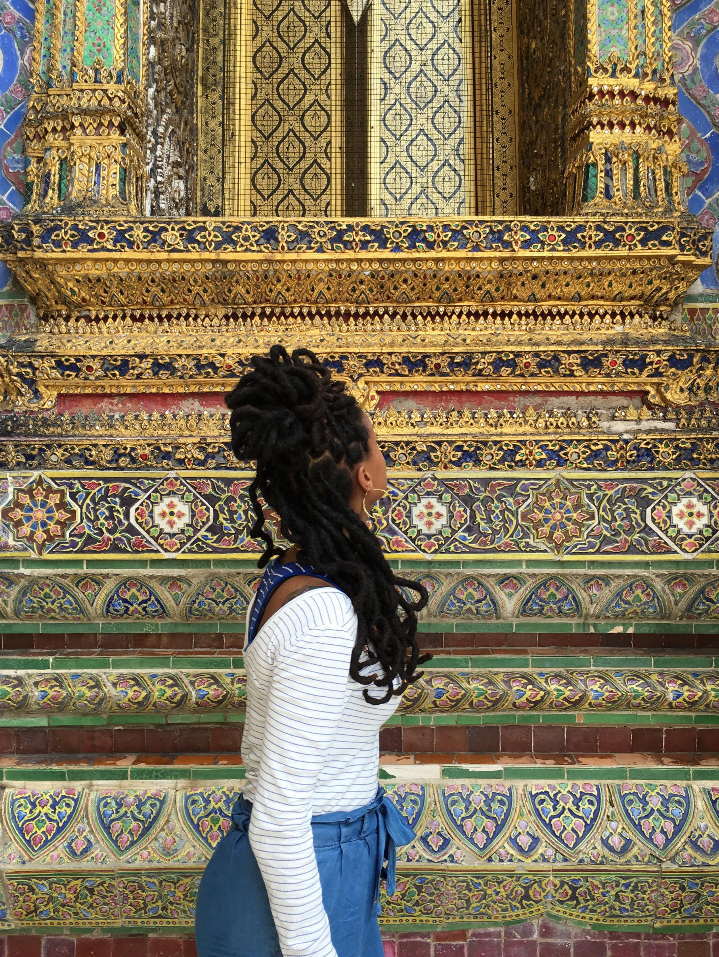 Examining details at the Grand Palace.