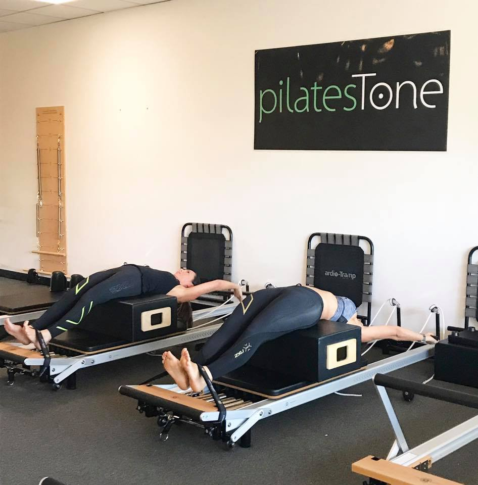 About PilatesTone - At PilatesTone you can expect a group class of heart pumping, muscle shaking, resistance training that tones and sculpts long lean muscles from head to toe. We believe in a modern athletic based approach at PilatesTone to our Reformer & Matwork classes.In each class we focus on core strength, flexibility, posture and toning with repetitive small movements that engage each muscle group.  You end up with longer leaner muscles in less time than a traditional Pilates Matwork class.We are a boutique studio with 8 reformers and cardio tramps, one-on-one attention in each class.Learn more ➝