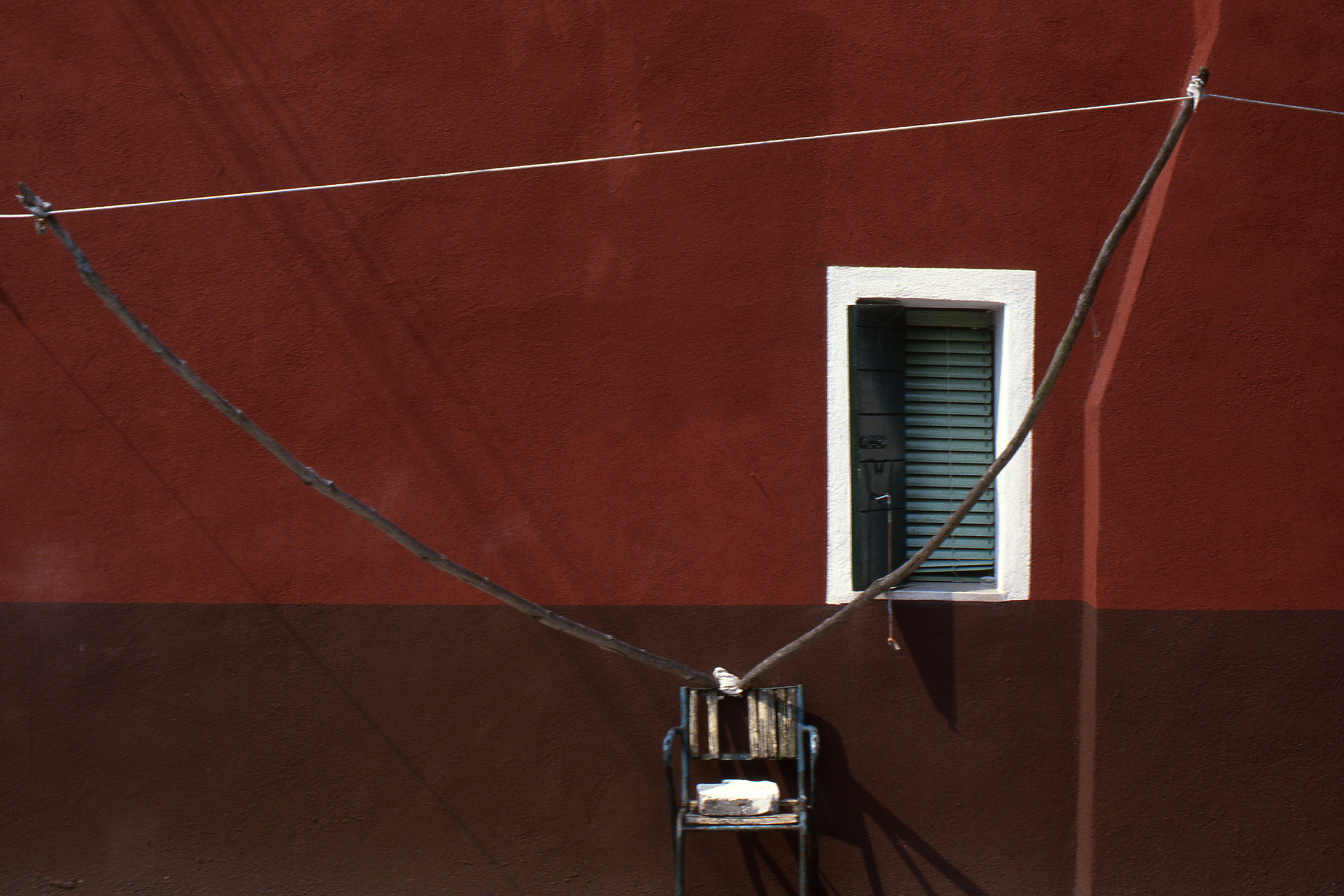 Red Wall with Clothesline, Burano Italy, 1978 ,Cibachrome Print, 16 x 24cm, Edition of 10.              Exhibition:  Burano Colour Works ,Australian Centre for Photography, Sydney; Solander Gallery, Canberra; Wagga Wagga City Art Gallery,Wagga Wagga, 1979.
