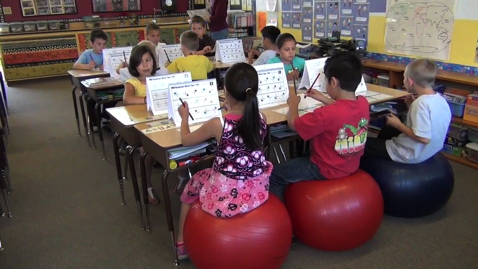 You'll learn how to integrate S'cool Moves activities seamlessly into your jam-packed school day. Students are doing Quadrant Word Taps to learn sight words, improve vision skills, rapid naming, and executive functioning.