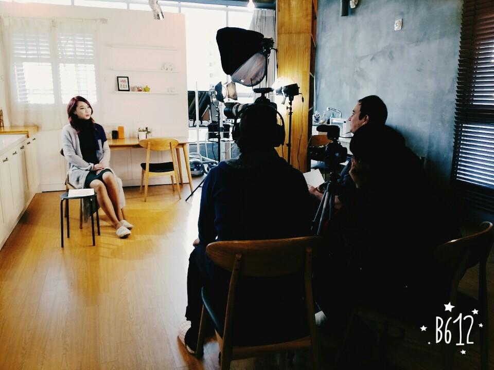 Model being interviewed