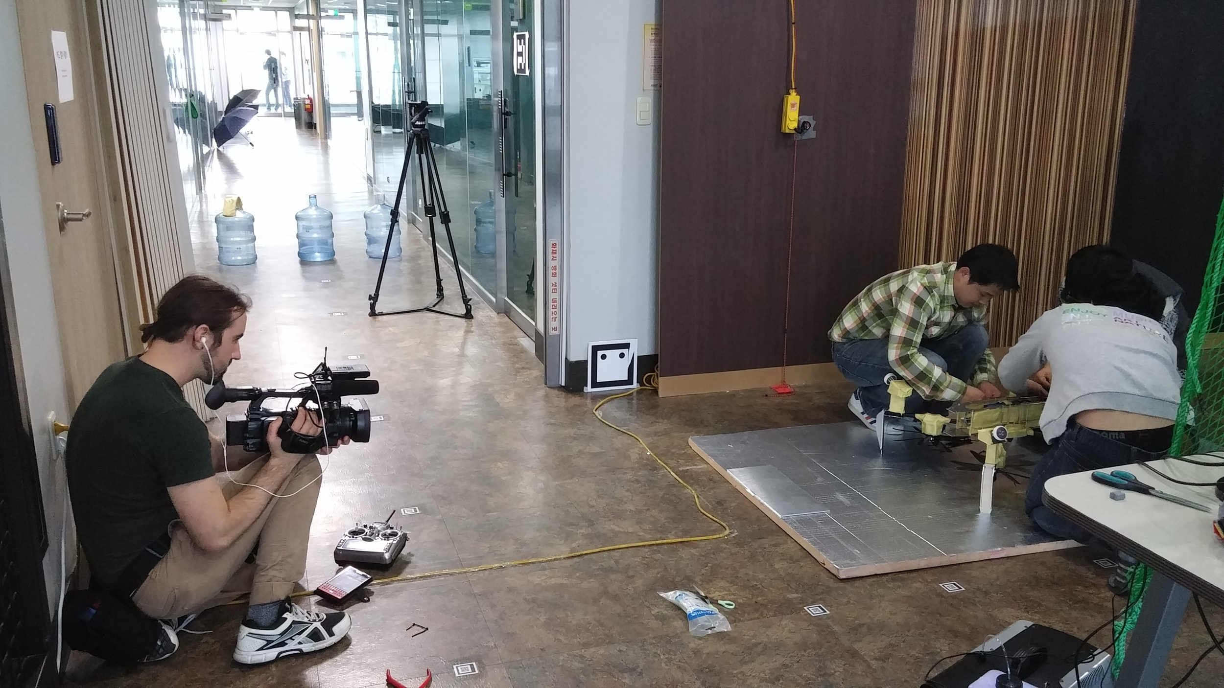 Filming the team at work on the drone