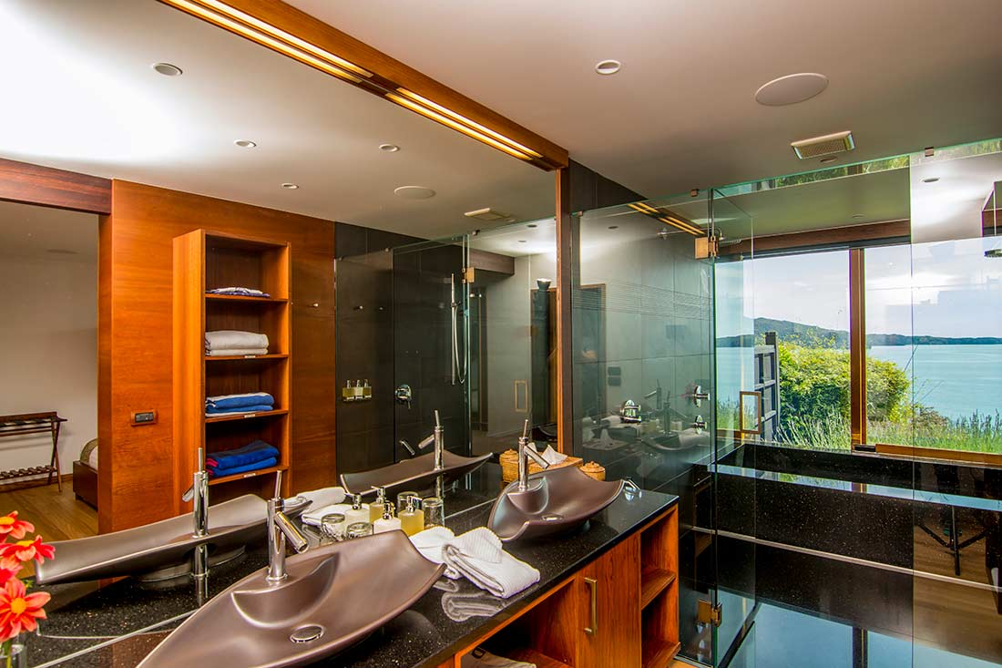 Polished black granite Japanese-style bath tub with 180-degree ocean views