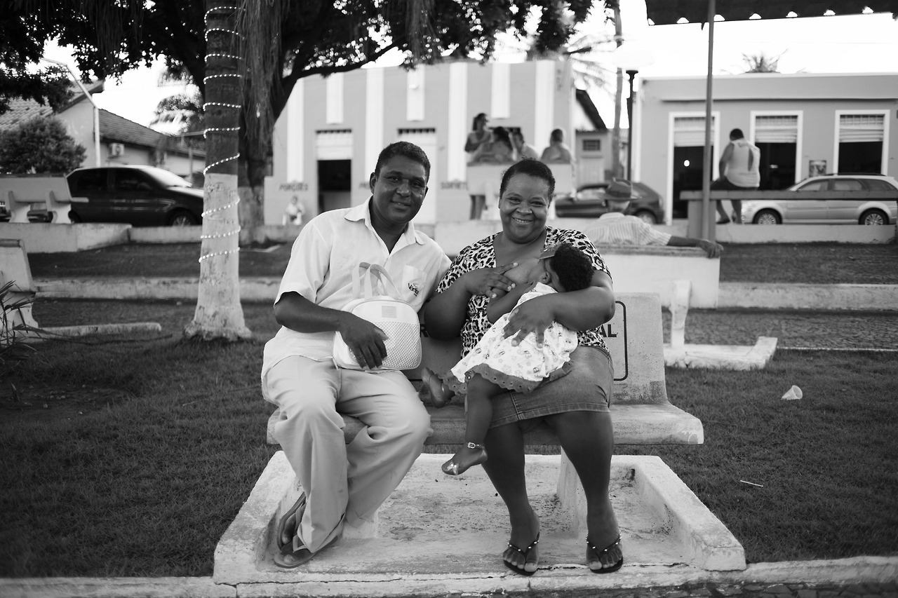 I met Sandy and her baby and husband when I was in Uru, Brazil. Thankfully my partner was with us and could translate so that I could ask to take their picture. Gorgeous family. I love this picture so much.