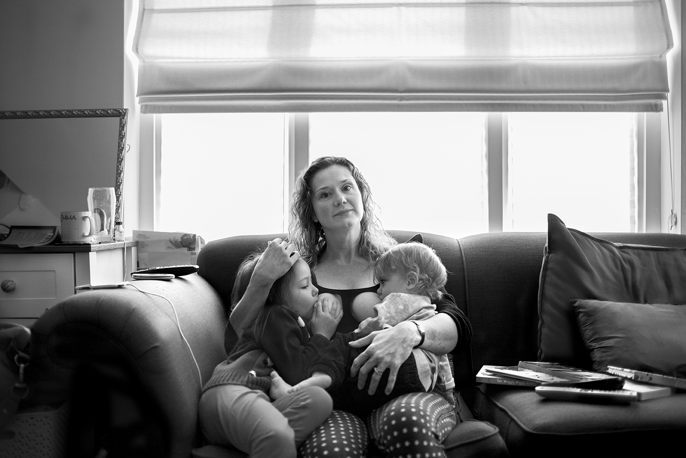 """My breastfeeding relationship has been all about learning and working.     With my daughter I was in agony for ten weeks. We never really worked out why. But I kept going and suddenly it became pain free. So we carried on to three months, then six, then a year and then I couldn't see a point in stopping when it was now so easy and such a great parenting tool. It calms tantrums (toddler and beyond!) so quickly and easily, offers comfort, and is a space to just be for both of us. Now she's six it's infrequent. Her adult teeth are coming in, her jaw shape is changing. She actually can't get milk any more. But still asks to nurse to reconnect, chill out, and just be close. She will stop when she's ready.     I didn't plan this. I told a friend ""I'm not going to be like you, feeding a child at school"", but actually it's easy and natural and normal (biologically speaking) and the gift of natural term weaning is one of the greatest I can give to my child.     My son is 16 months, still tiny and loves feeding. He had a tongue tie so it was very hard for the month before it was cut. Painful, with him not getting enough. One day we had no wet nappies at all. But I kept going and trusted my body and once the tie was cut he latched on and within a few days would suck for comfort and not just food. It felt like a miracle. But then birth and breastfeeding are miracles.     I feed in public. Any time, anywhere. I walk around places with my boy in my arms, latched on, while I chat to people, order coffee, tidy up, whatever. I fed my daughter in public till she was three, then I felt conscious. But this time I will feed in public longer. I feel more confident about natural term weaning now. I love being able to tandem feed. Sometimes they hold hands. Sometimes my son tries to unlatch his sister, poking his finger in her mouth, or pokes her eyes. He shares his boobs reluctantly!    My mum fed me till I was five months. I didn't ever consider any other way to feed my babies. I trust my body to feed them. Formula was never an option. I have friends who would wet nurse for me, and I for them, if it was ever necessary.     My advice to others? Just do it. Other people's opinions don't matter. Not even your partner's. Get the right support and do what's right for you and your child."""