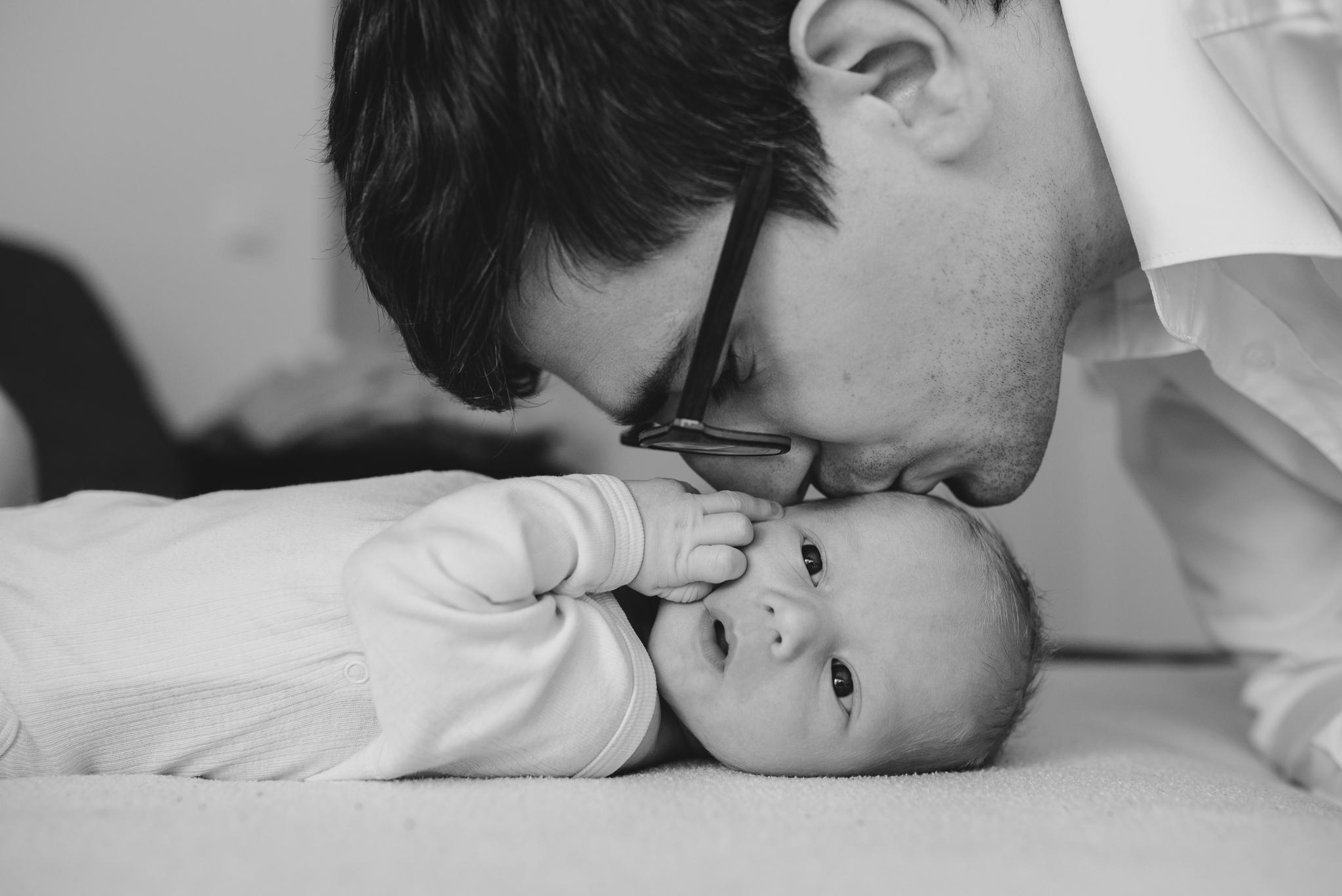 Dad kissing baby son.jpg
