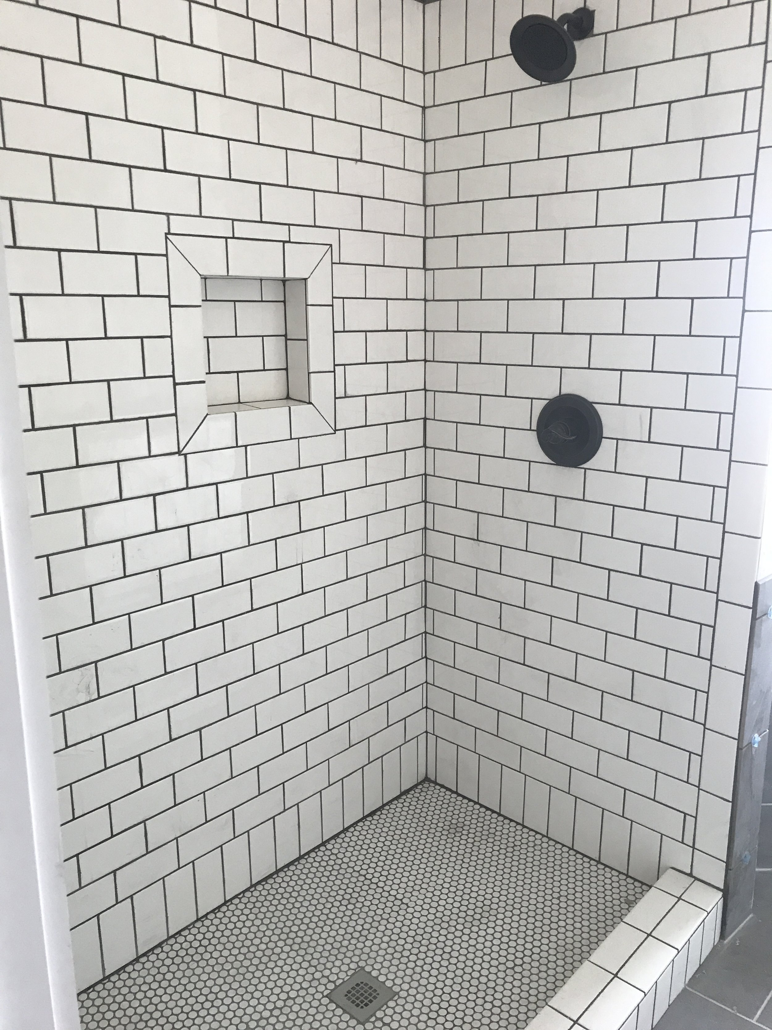 The master bath features this amazing white subway tile shower with a custom glass door.