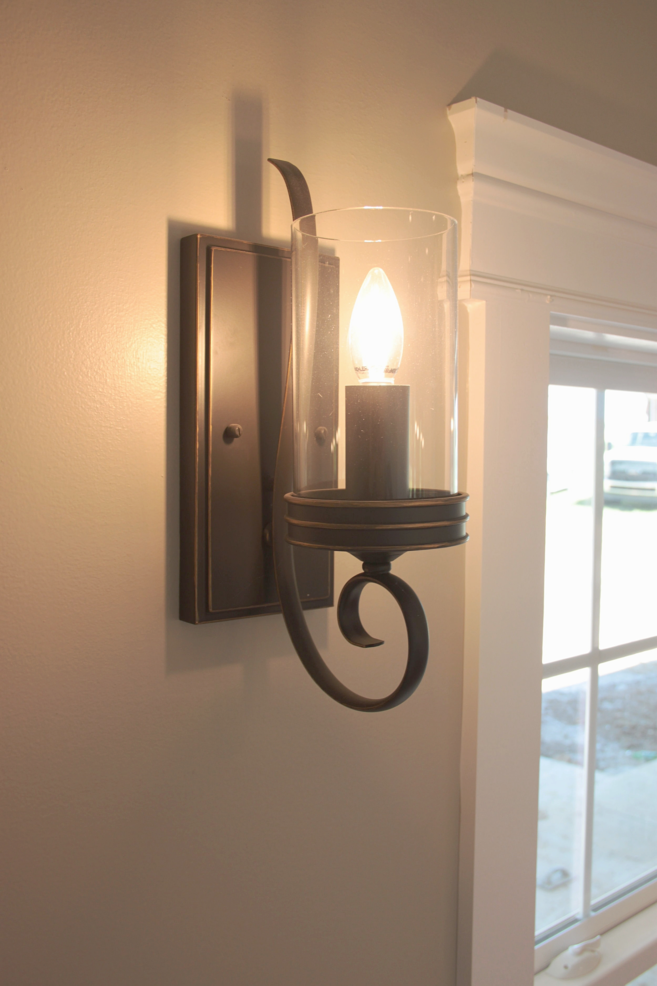 Sconce lighting above the breakfast nook in the kitchen.