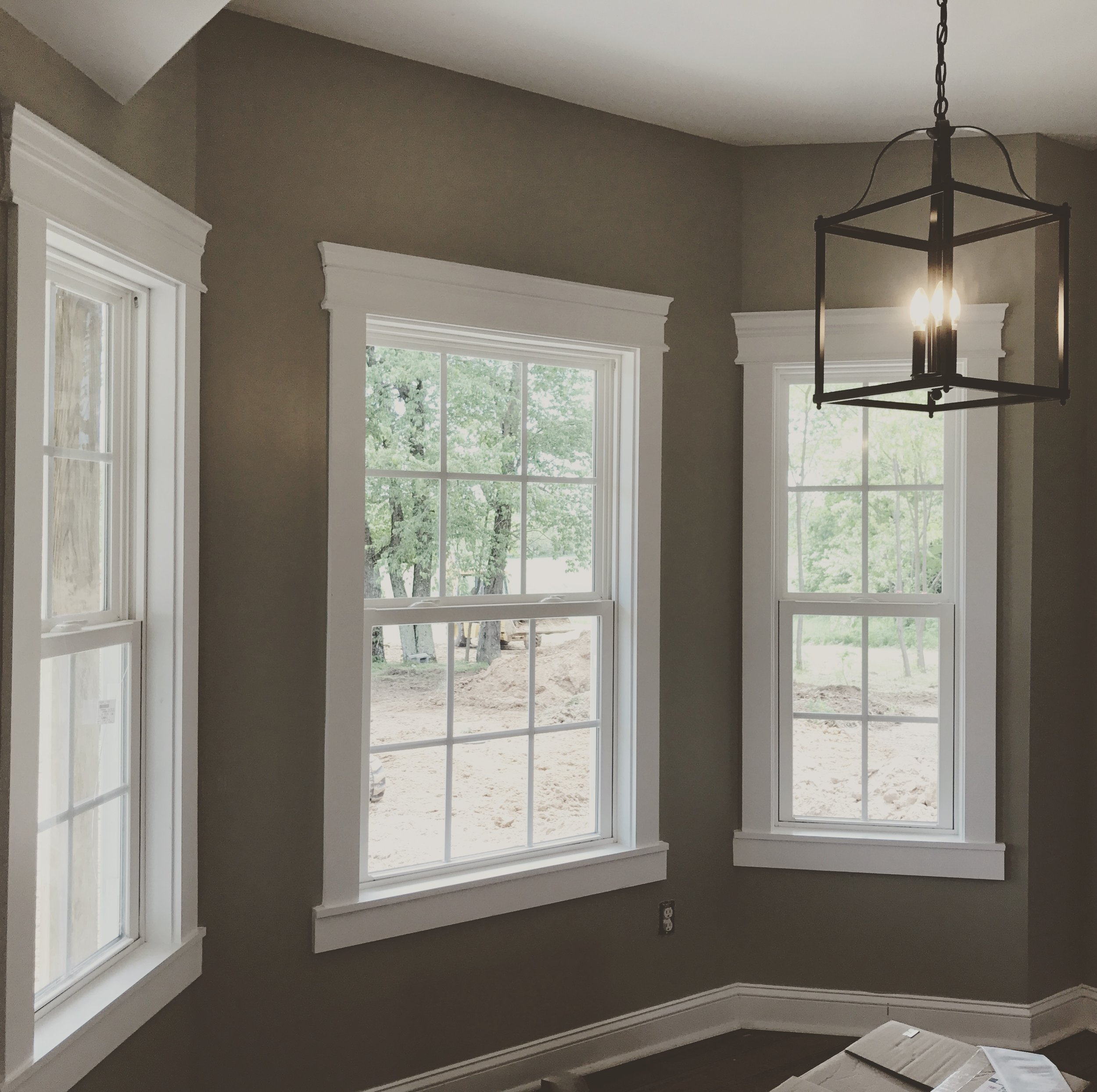 Beautiful farmhouse style trim work sets off the view of the countryside.