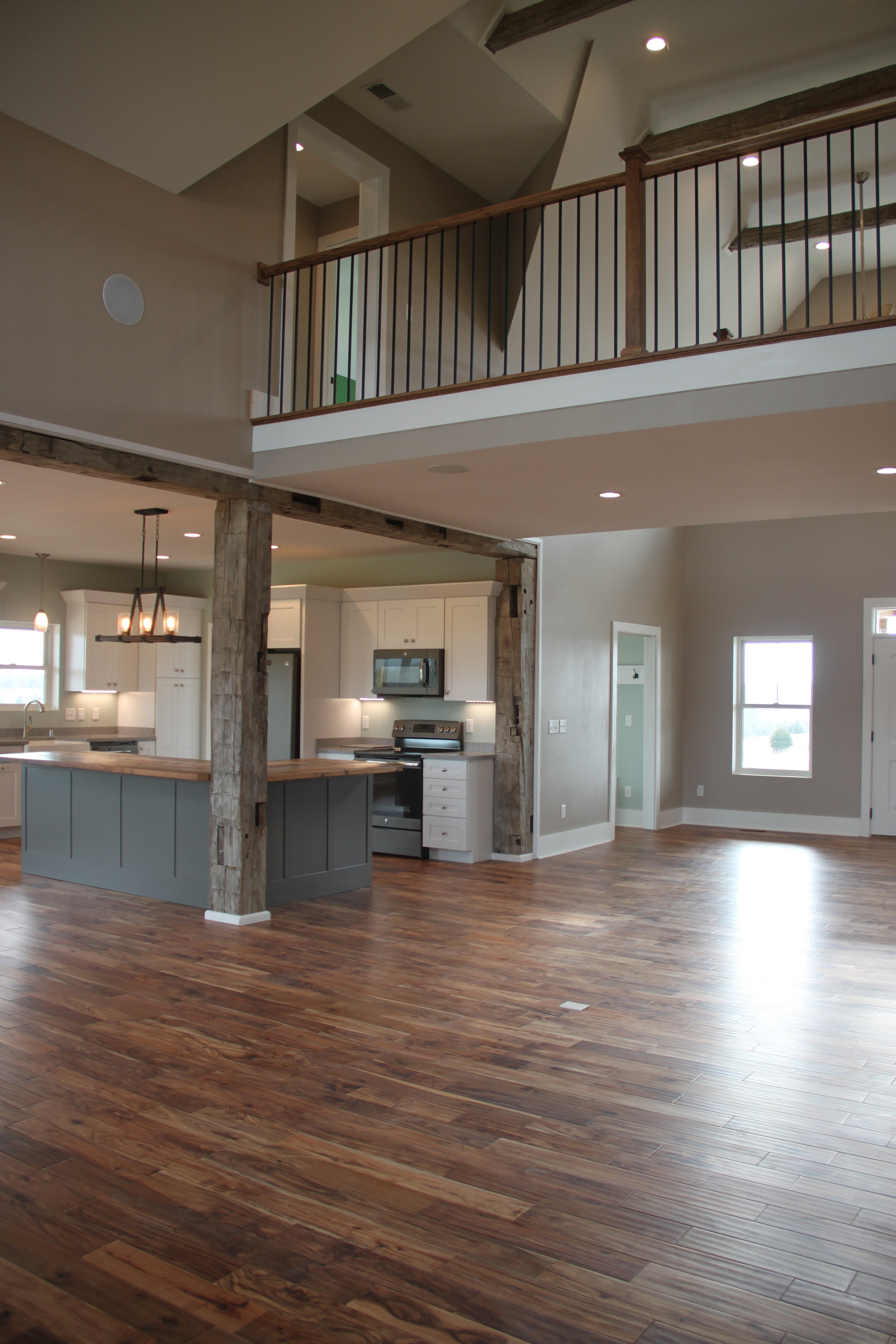 The Sadieville Lodge has vaulted ceilings with exposed beams....and a bridge on the 2nd story to access the bedrooms.