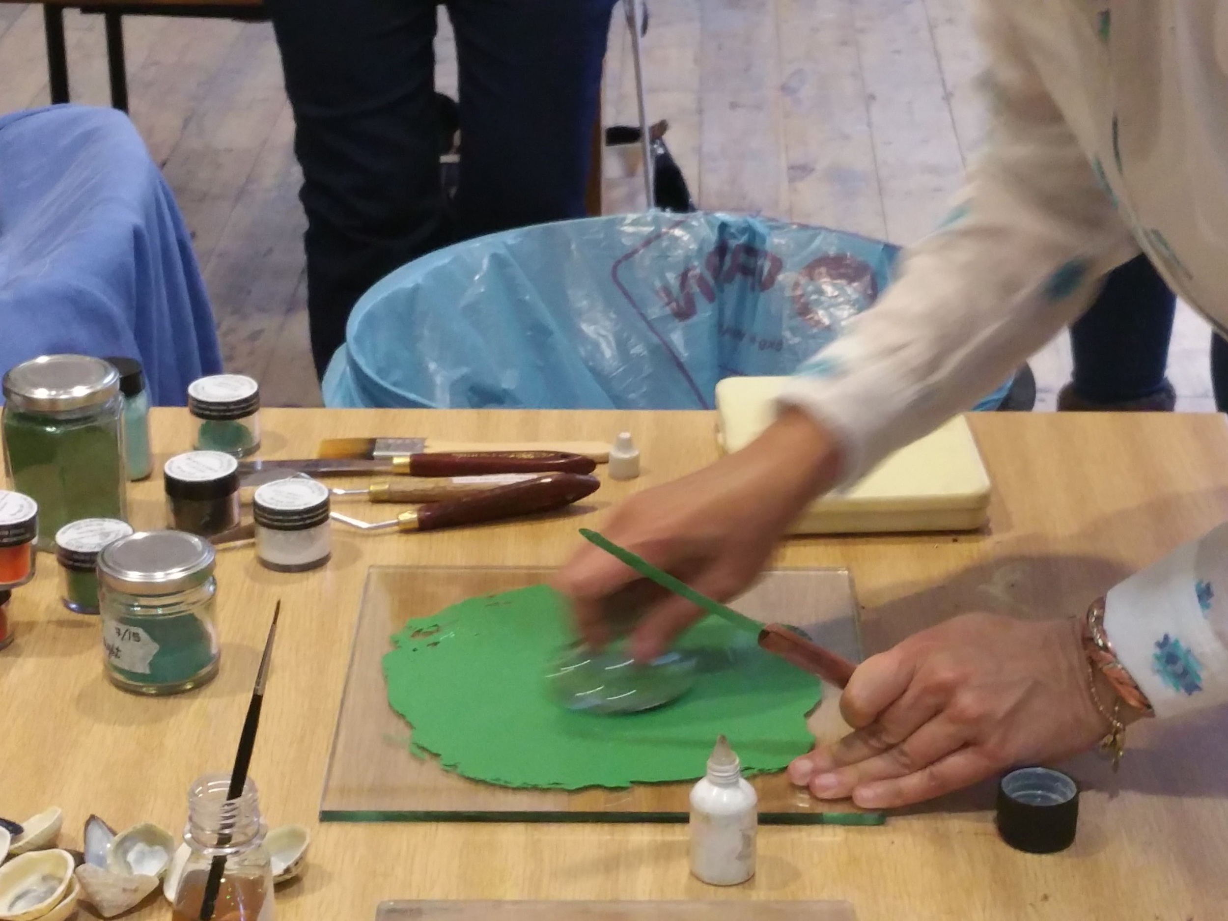 Grinding and mixing the pigment with a muller on a glass slab