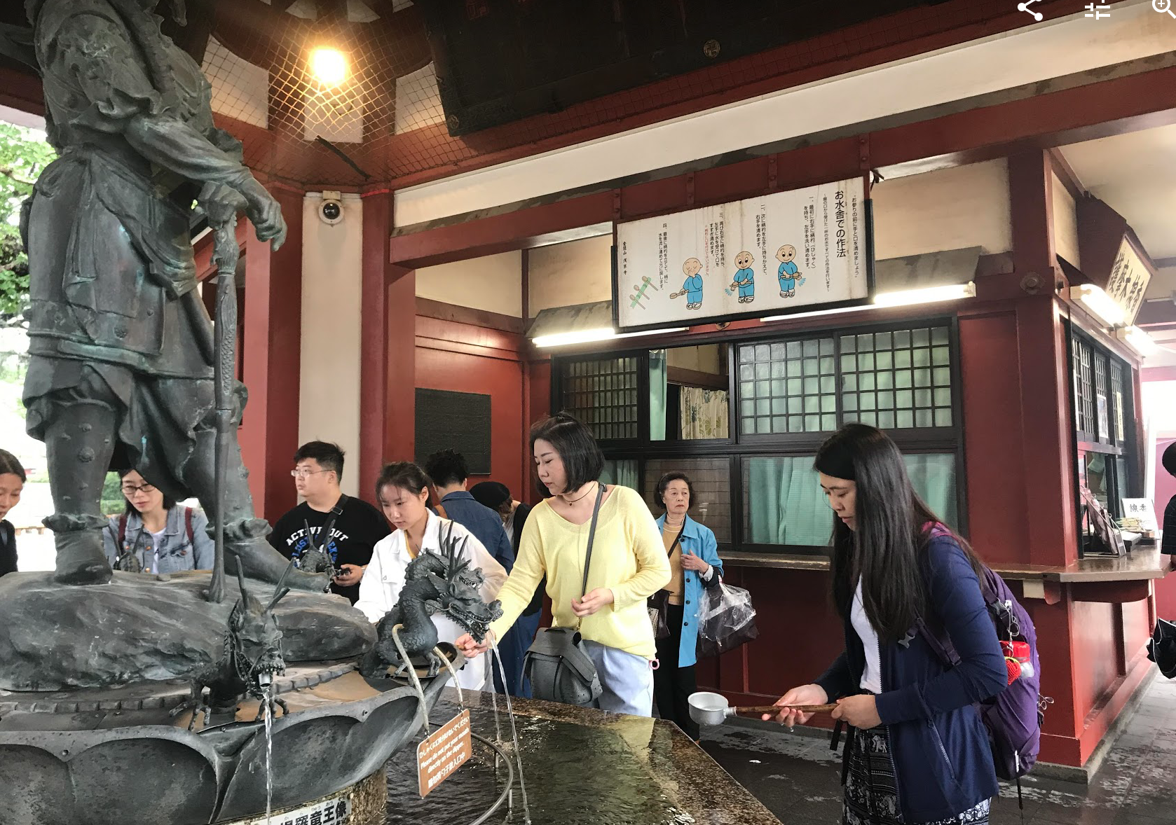 In Japan, I visited Asakusa which is known for the Sensoji, a popular Buddhist temple, built in the 7th century. That's the place I mainly stayed around, and this is a picture taken there. The idea is to wash your hands and face with the water to bring you luck!