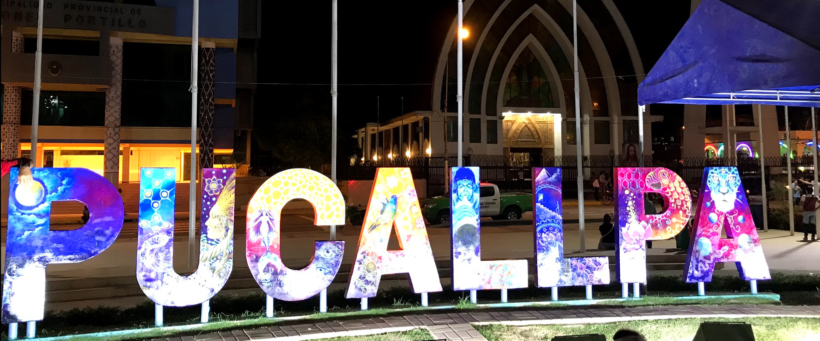 The city in which I stayed at. Here, this is take an the Pucallpa Plaza, the most urban region of the city. There's a center plaza with this sign and markets all around. There's also really good passion fruit ice cream here!