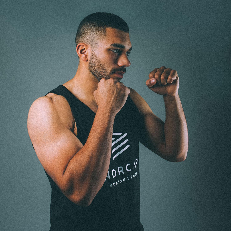 149_UNDRCARD_Boxing_Studio_Calgary_boxing_classes_instructor_cornercrew_JordanJohnson.jpg