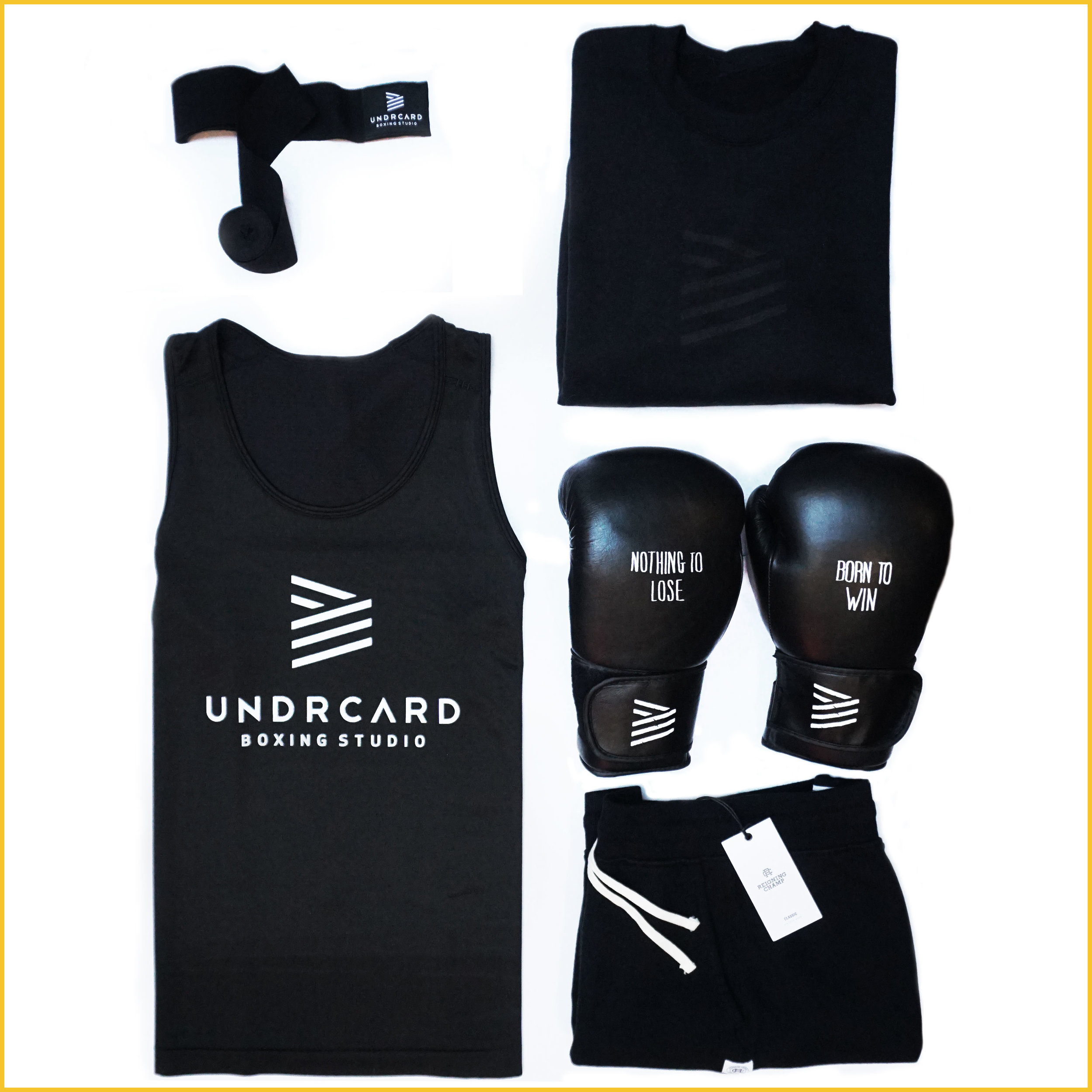 THE REBEL  We have the complete line-up for the health goth in your life.  UNDRCARD Stealth Crew ,  UNDRCARD hand wraps ,  Lululemon men's metal vent tank top ,  Reigning Champ shorts ,  UNDRCARD Born to Win gloves .