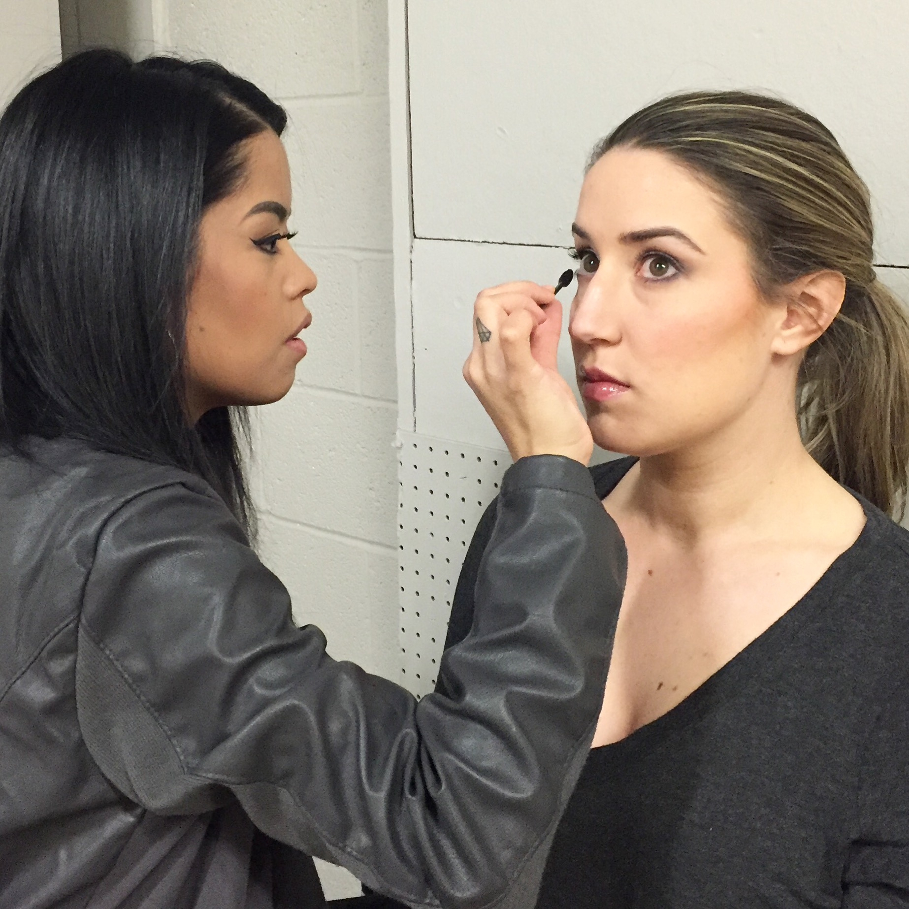 Samantha applying makeup for one of the beautiful models.