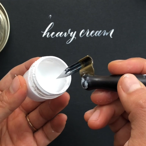 Dipping calligraphy nib into bleedproof white.png