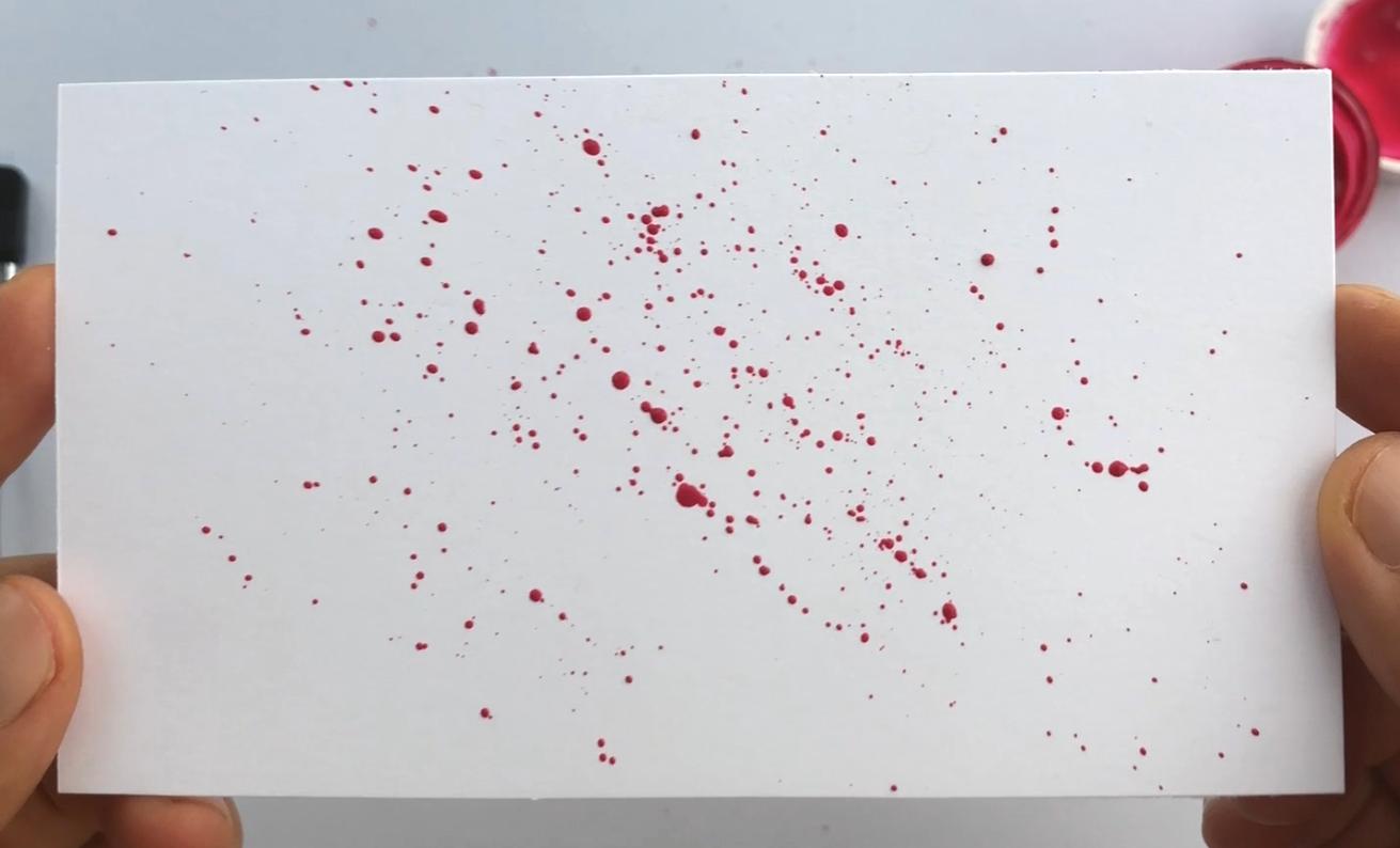 Ink splatters for calligraphy using paintbrush bristles