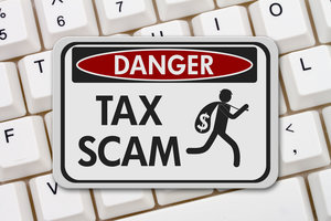78548162 - tax scam danger sign, a black and white danger sign with text tax scam and theft icon on a keyboard