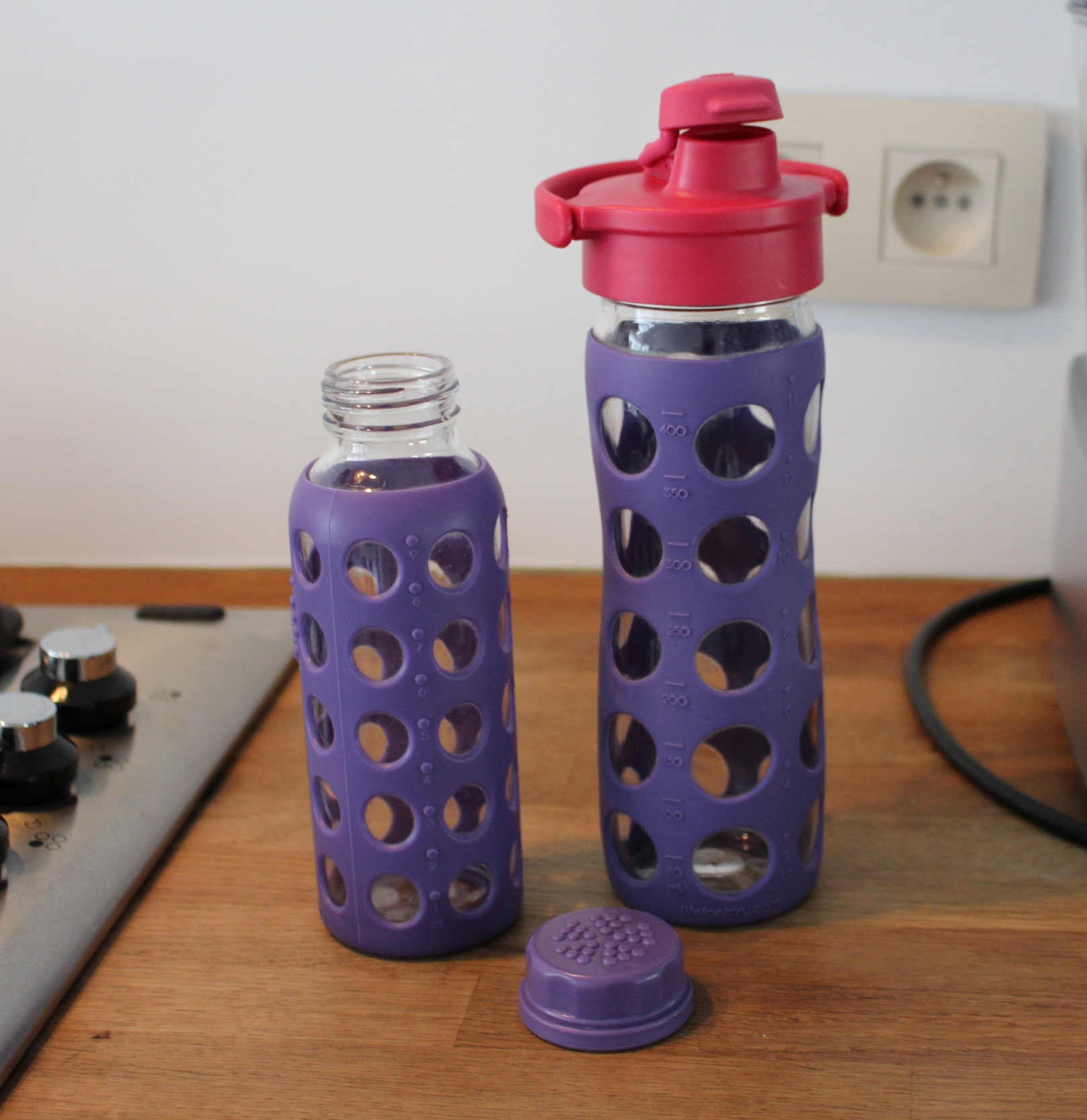 Image: my own lifefactory bottles. Two purple ones, one small 9oz bottle and one 16oz with fuscia bottle cap.
