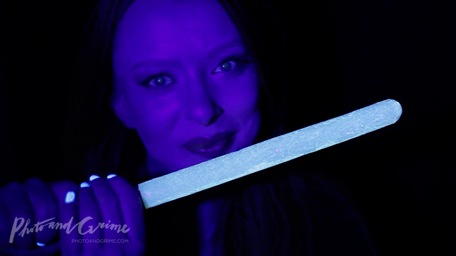 Edible blue UV Glow in the Dark Star Wars lightsaber made with quinine (Tonic).
