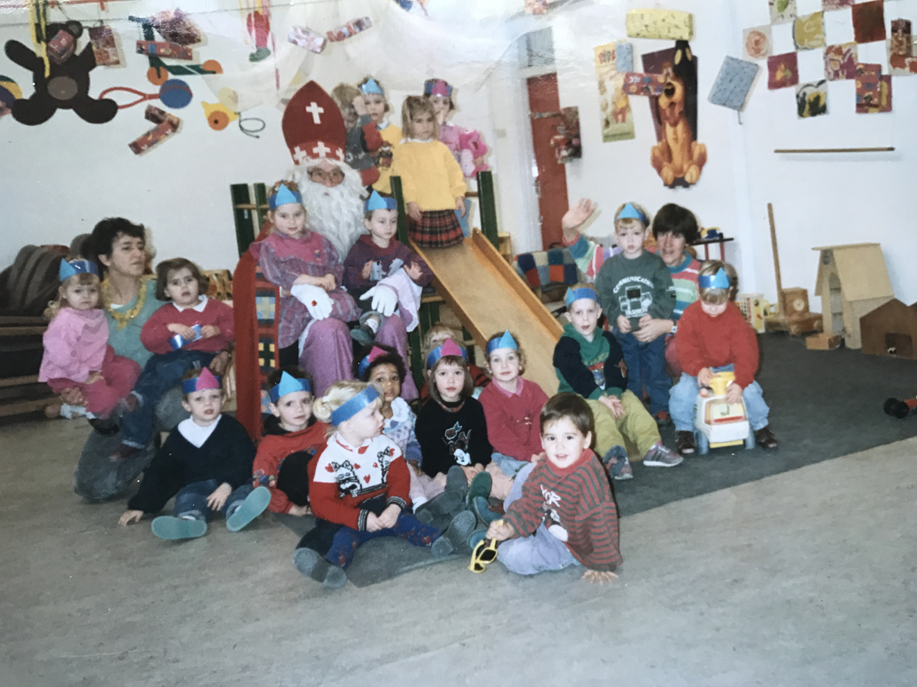 Celebrating Sinterklaas (I'm from the Netherlands) at preschool. The blonde girl sitting in the front row is me.