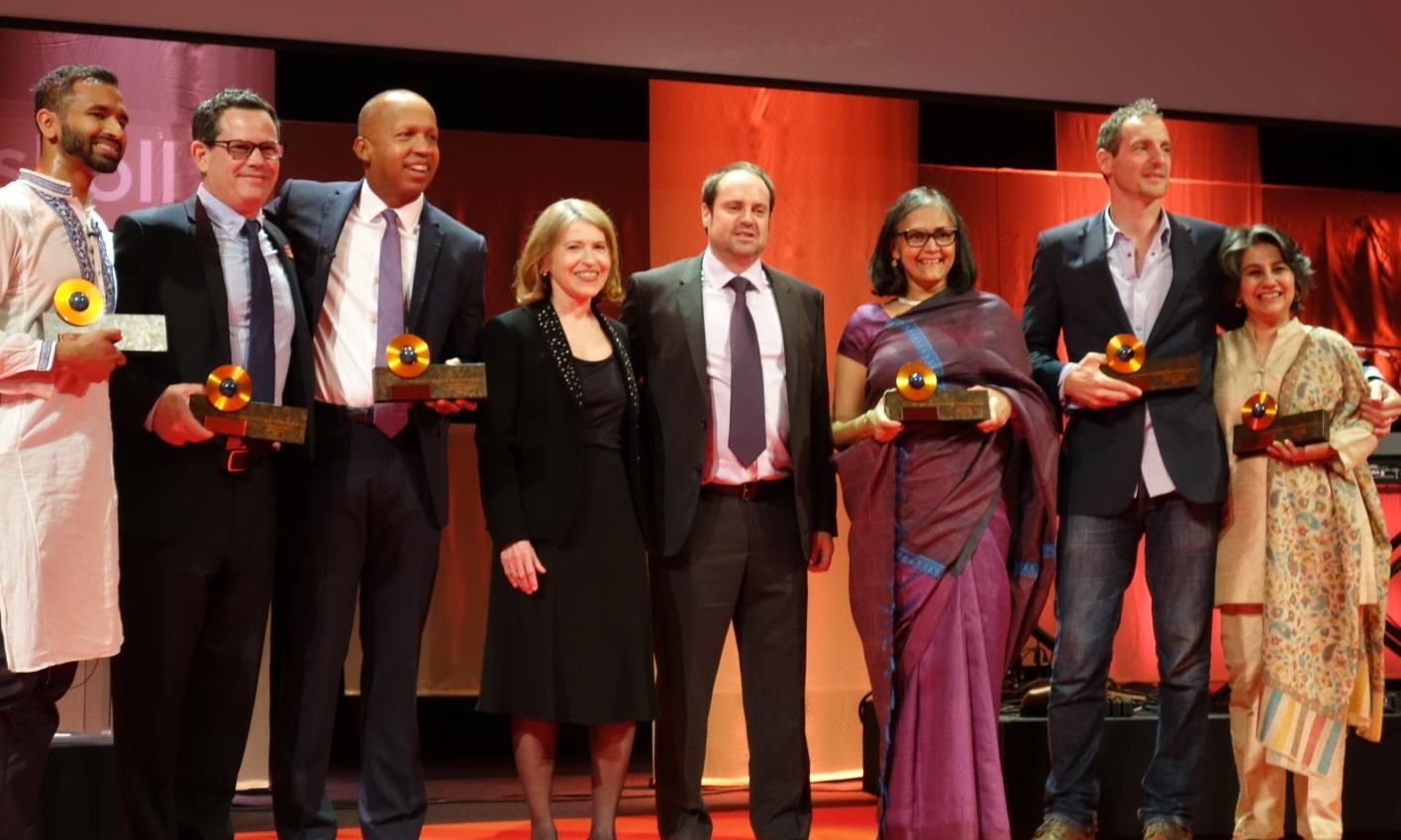 Skoll Awardees Vivek Maru, Chuck Slaughter, Bryan Stevenson,Skoll Foundation CEO Sally Osberg, Jeff Skoll, and Skoll Awardees Mallika Dutt, Oren Yakobovich and Sonali Khan.