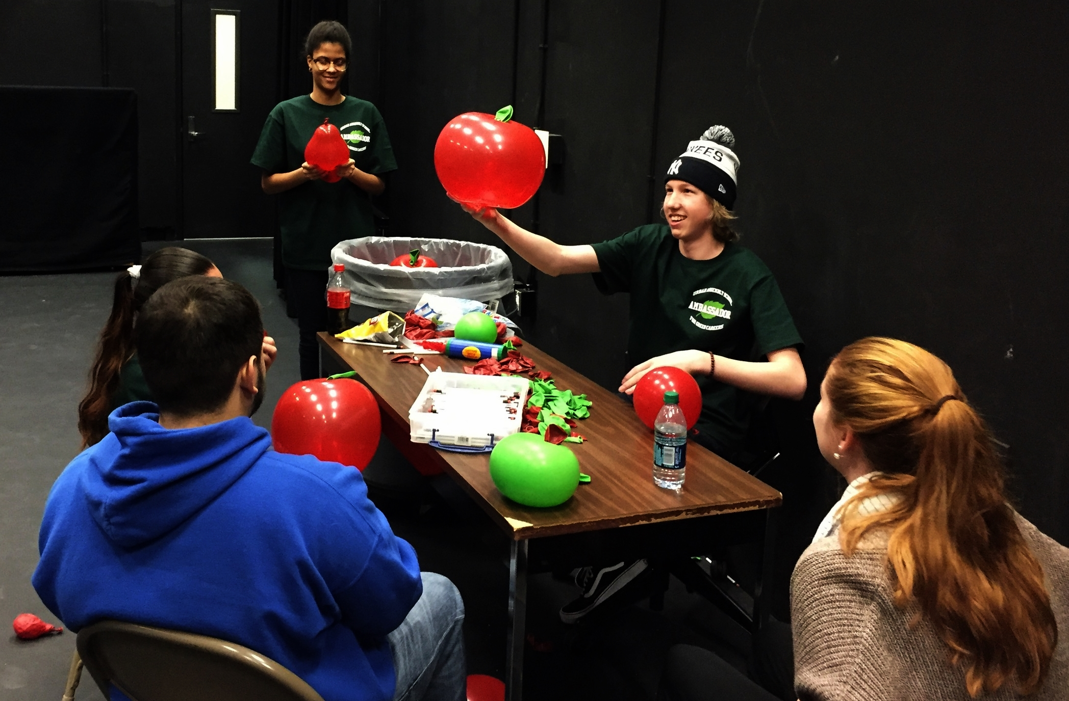 UAGC Ambassadors making balloon apples for expo participants with Barnes & Noble materials