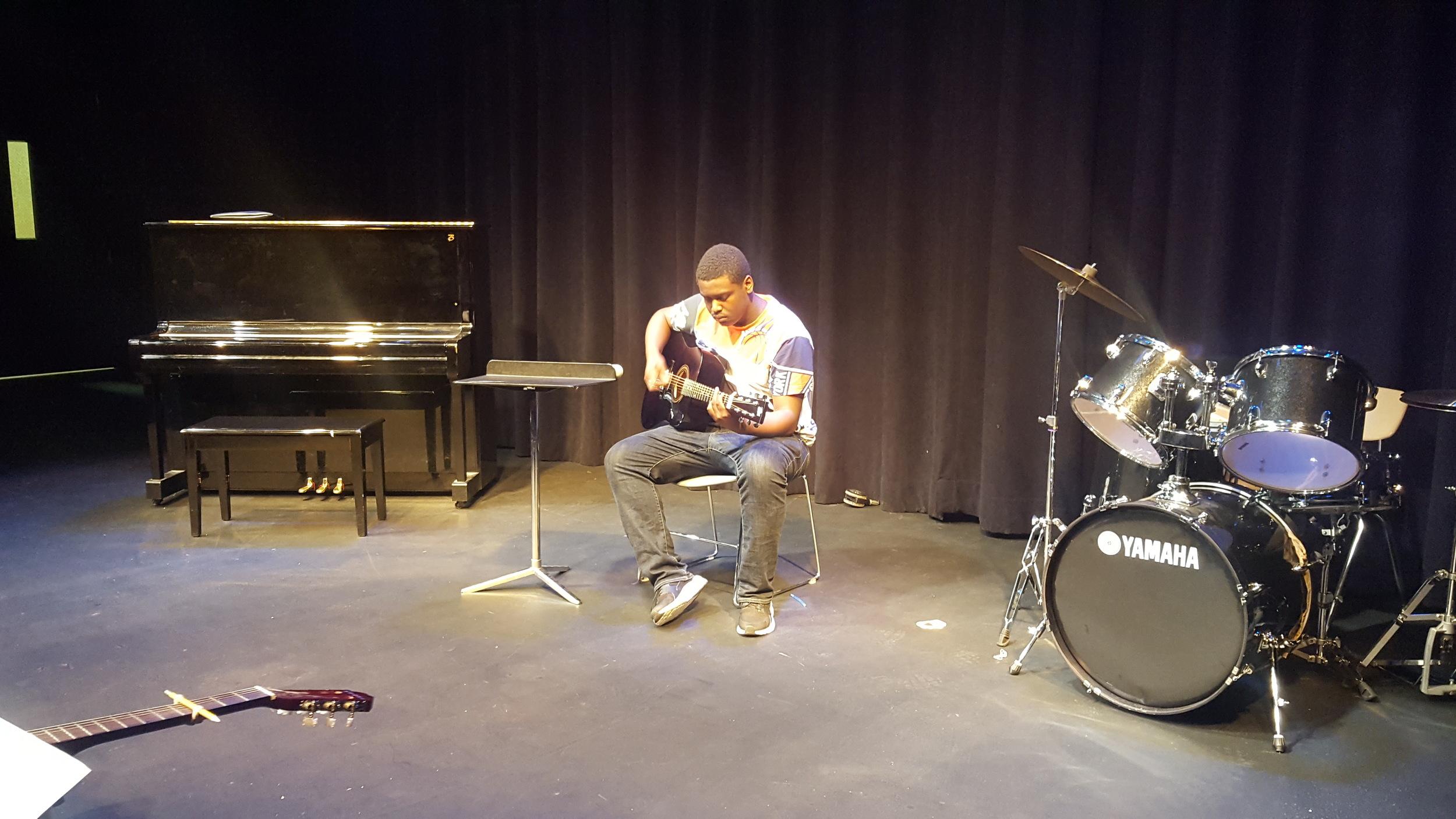 Sophomore Gary Bacchus on guitar
