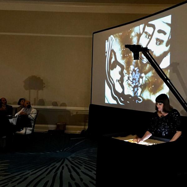 Sand Artist   Charlene Lanzel performing live in Florida.