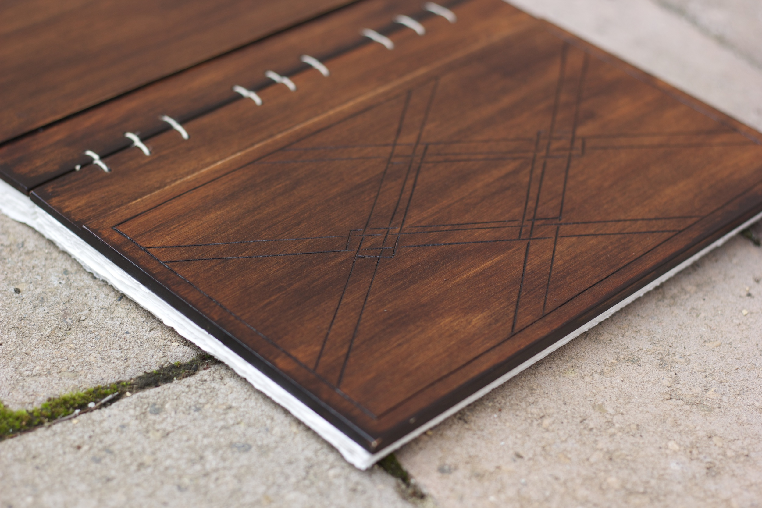 Kickstarter project. Wood-cover journal. Pyrography on front cover. 2013.