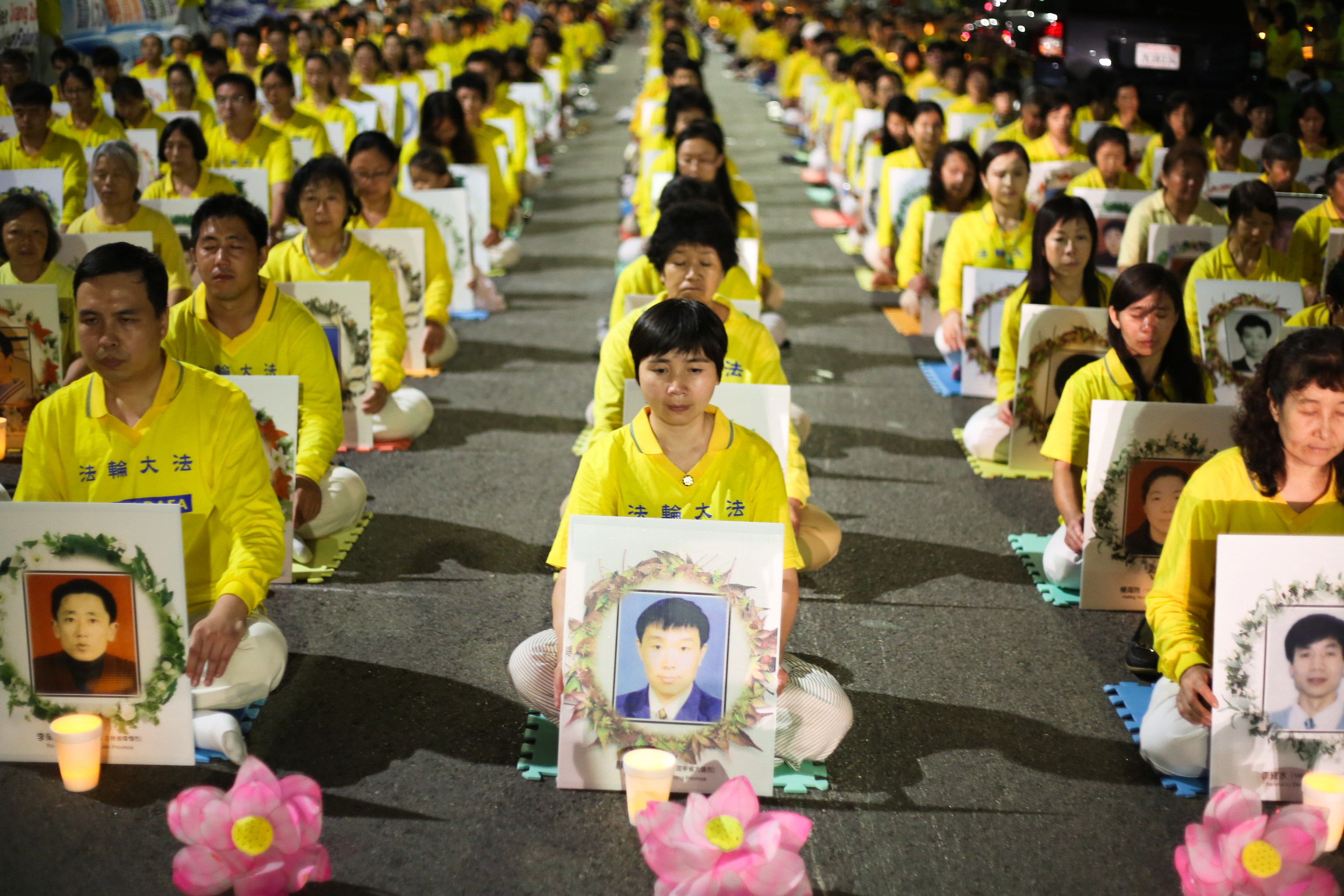Falun Gong practitioners demanding that former Chinese leader Jiang Zemin be brought to justice, hold a candlelight vigil in front of the Chinese Consulate in Los Angeles on Oct. 15, 2105, for those who have died during the 16 year persecution in China. (Benjamin Chasteen/Epoch Times)