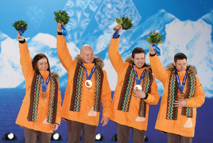 Rubenis on the podium with fellow Olympic bronze medals winners of the luge team relay event in February, 2014.
