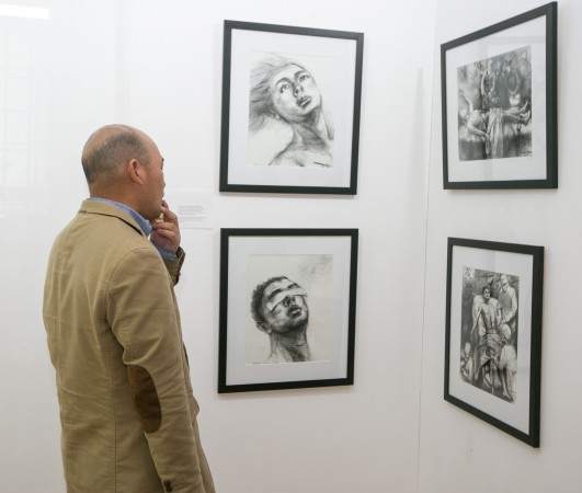 People attend an art exhibition by AAFOH (Artists Against Forced Organ Harvesting) in New York on May 10, 2016. (Benjamin Chasteen/Epoch Times)