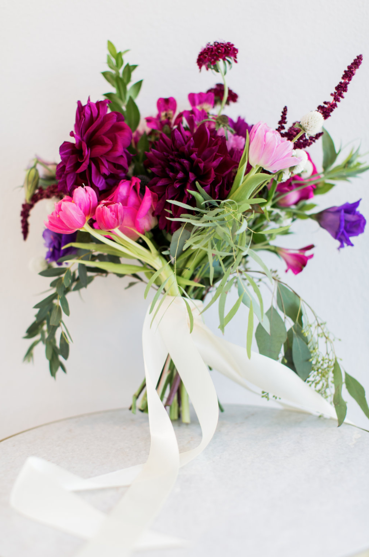 pink and purple bouquet with loose ribbon