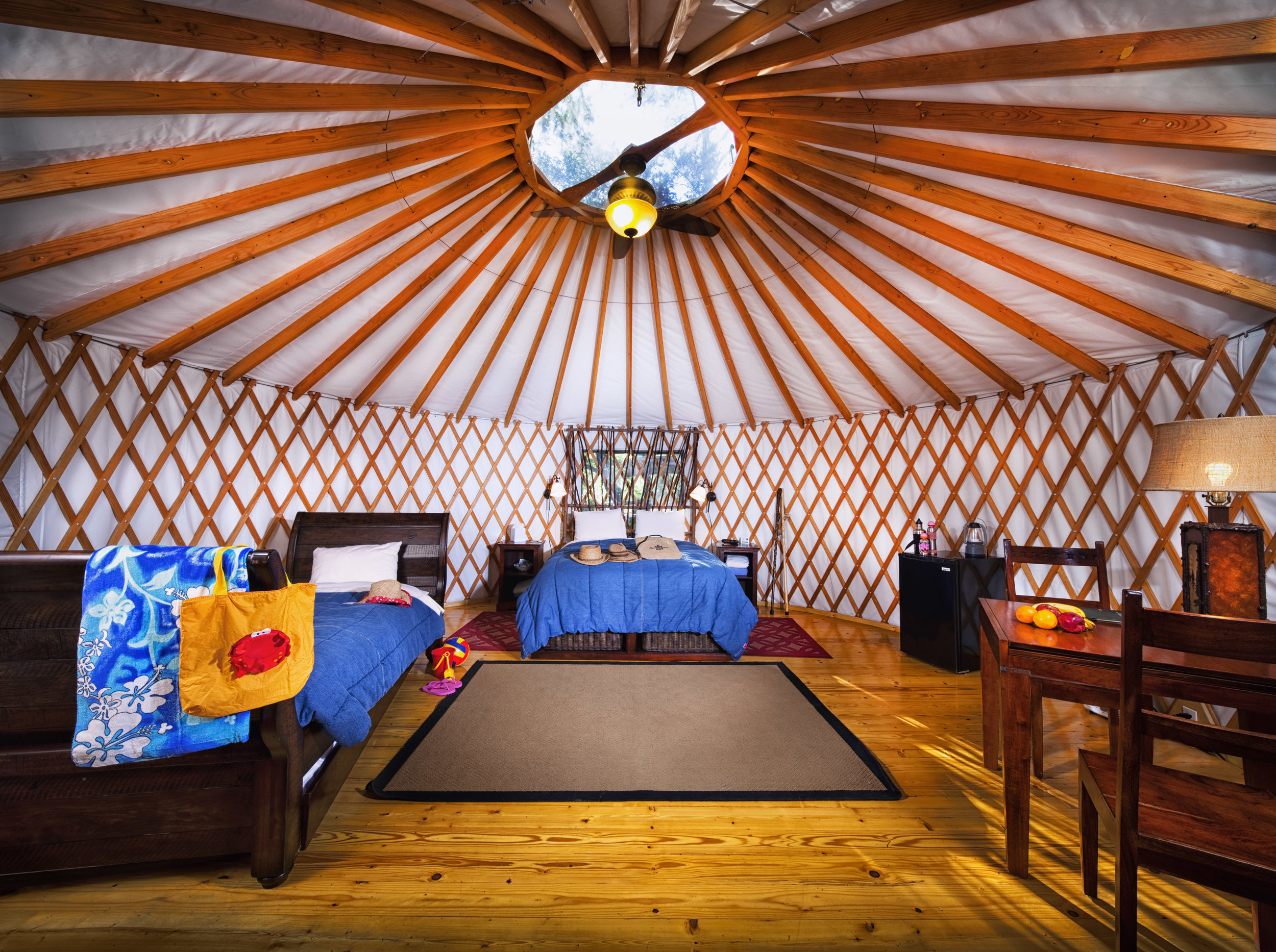 Adventure yurt$1800 / 2 nights - Sleeps 2 adults + 2-3 childrenFurnishings inside the Adventure Yurt include one queen bed and one twin day bed with twin trundle, which can accommodate a family of 4 comfortably. Electricity is provided inside the yurt and bathhouse amenities are located only steps away. As with every accommodation at El Capitan Canyon, the new Adventure Yurt also includes a private picnic table and firepit with removable grill for both grill dining and a cozy campfire.