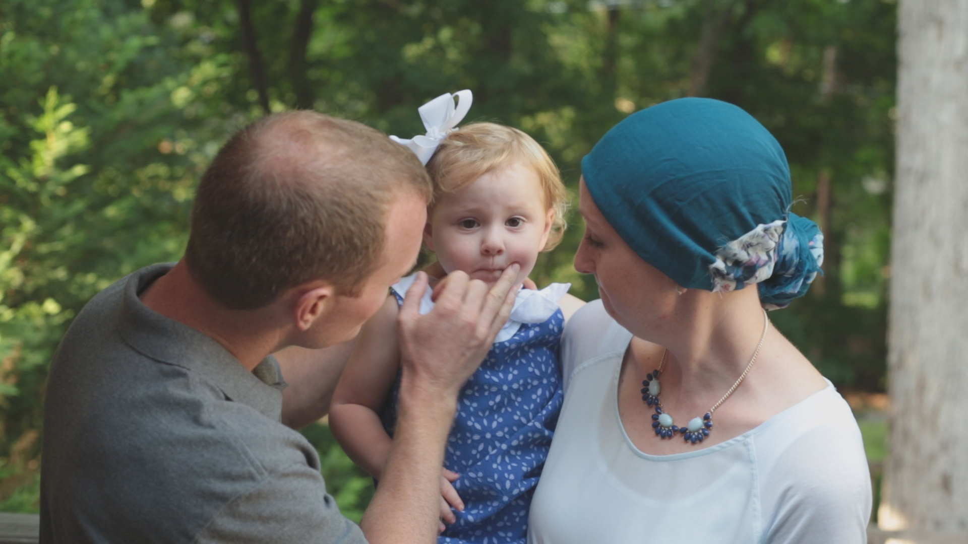 Breast cancer patient Lori Elliott and family posing for photo in Raleigh North Carolina