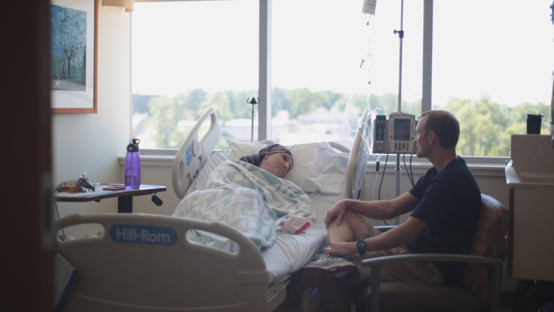 breast cancer patient Lori Elliott doing chemo at Duke Cancer Institute with husband