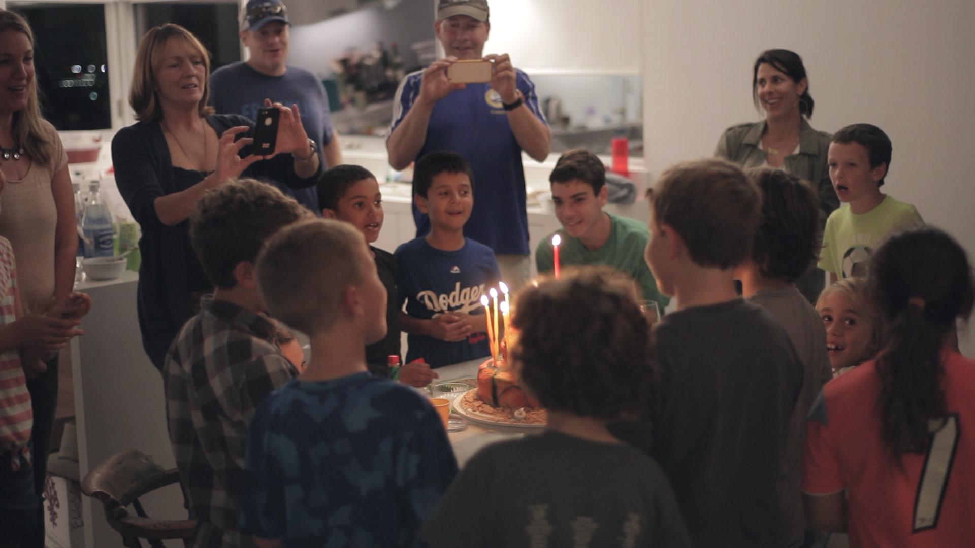 woodwalk-communigift-los angeles-birthday-boy-cake-candle-family-friends