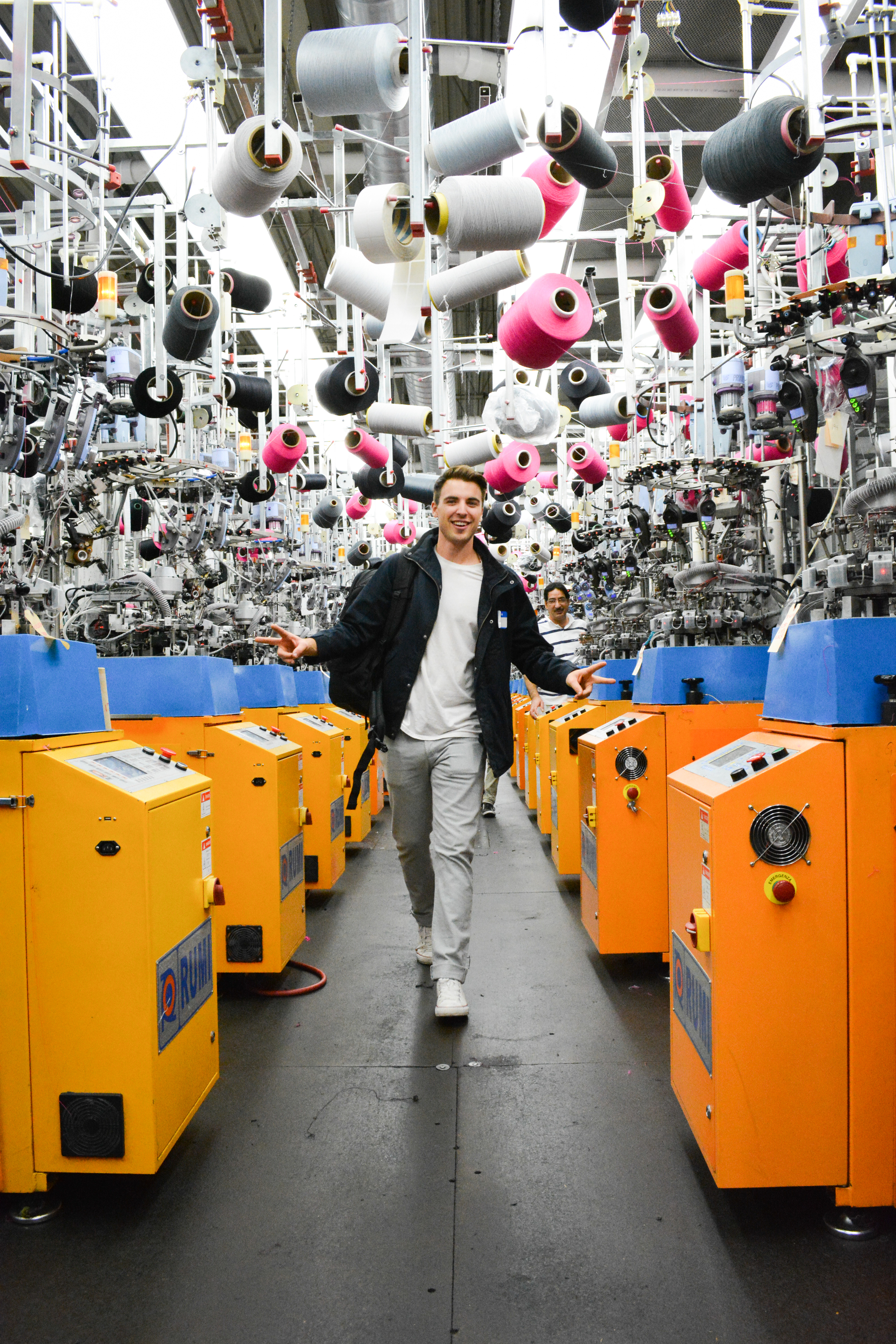 Will Anderson walks through sock factory during Woodwalk commercial in High Point
