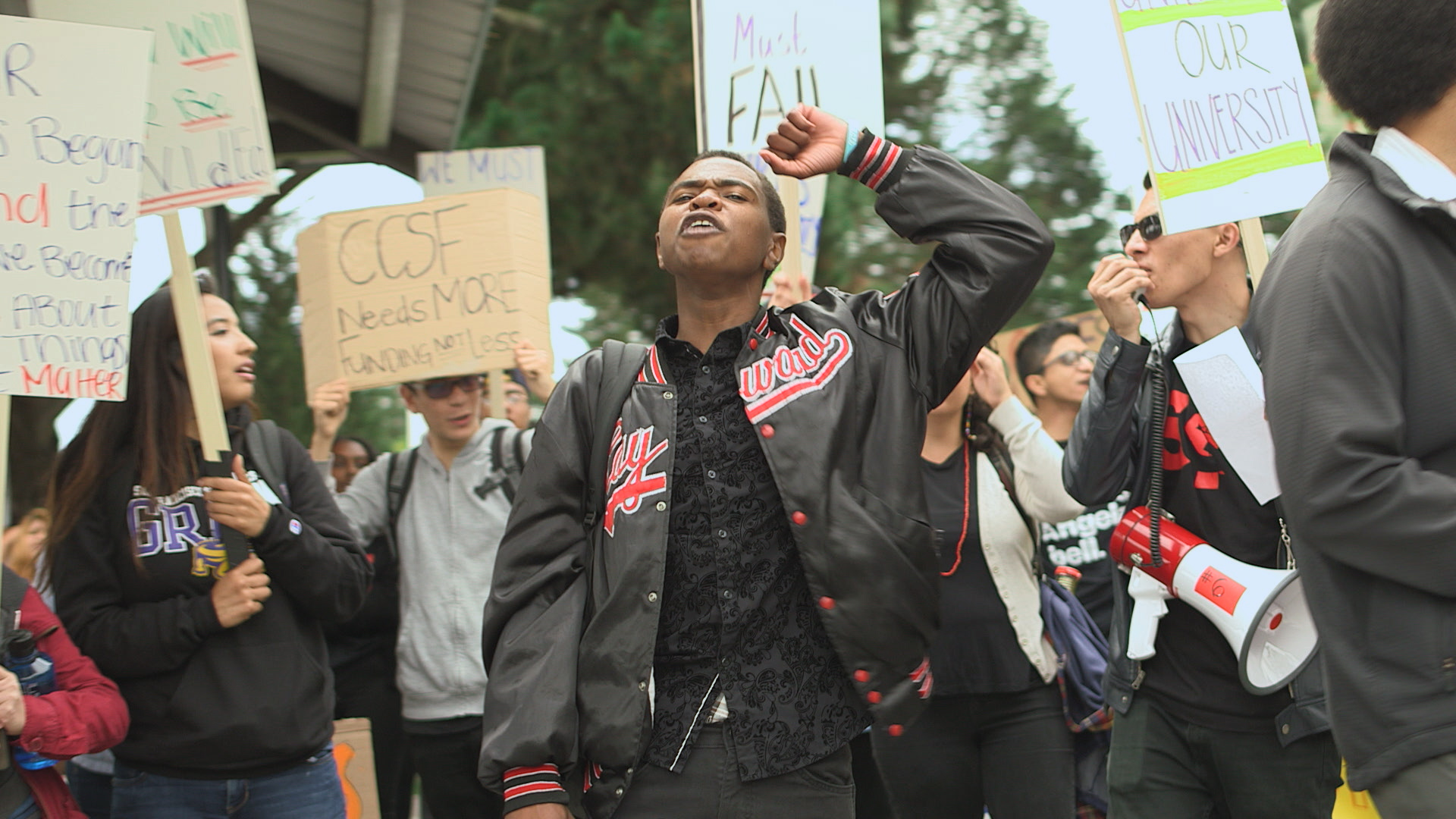 Black student protesting on college campus.