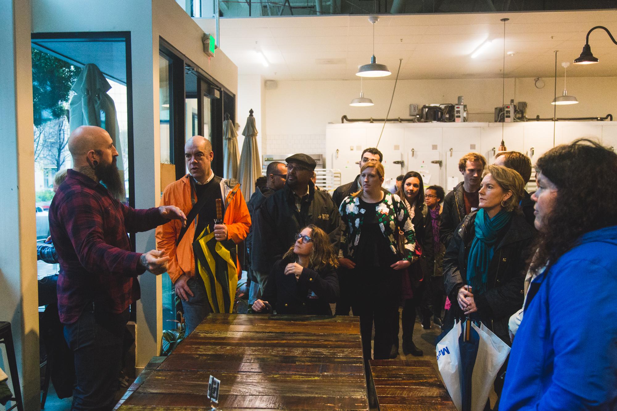 Matt Kreutz co-owner of Firebrand Artisan Breads talks with NewCo attendees.